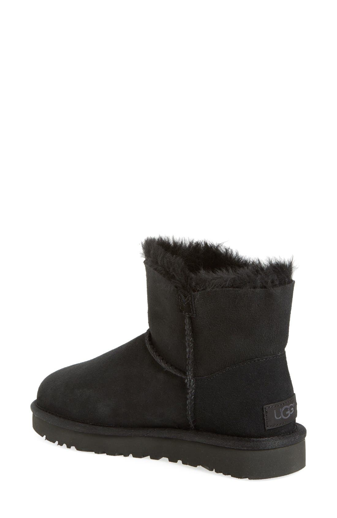 UGG<SUP>®</SUP>, Mini Bailey Button II Genuine Shearling Boot, Alternate thumbnail 2, color, BLACK SUEDE