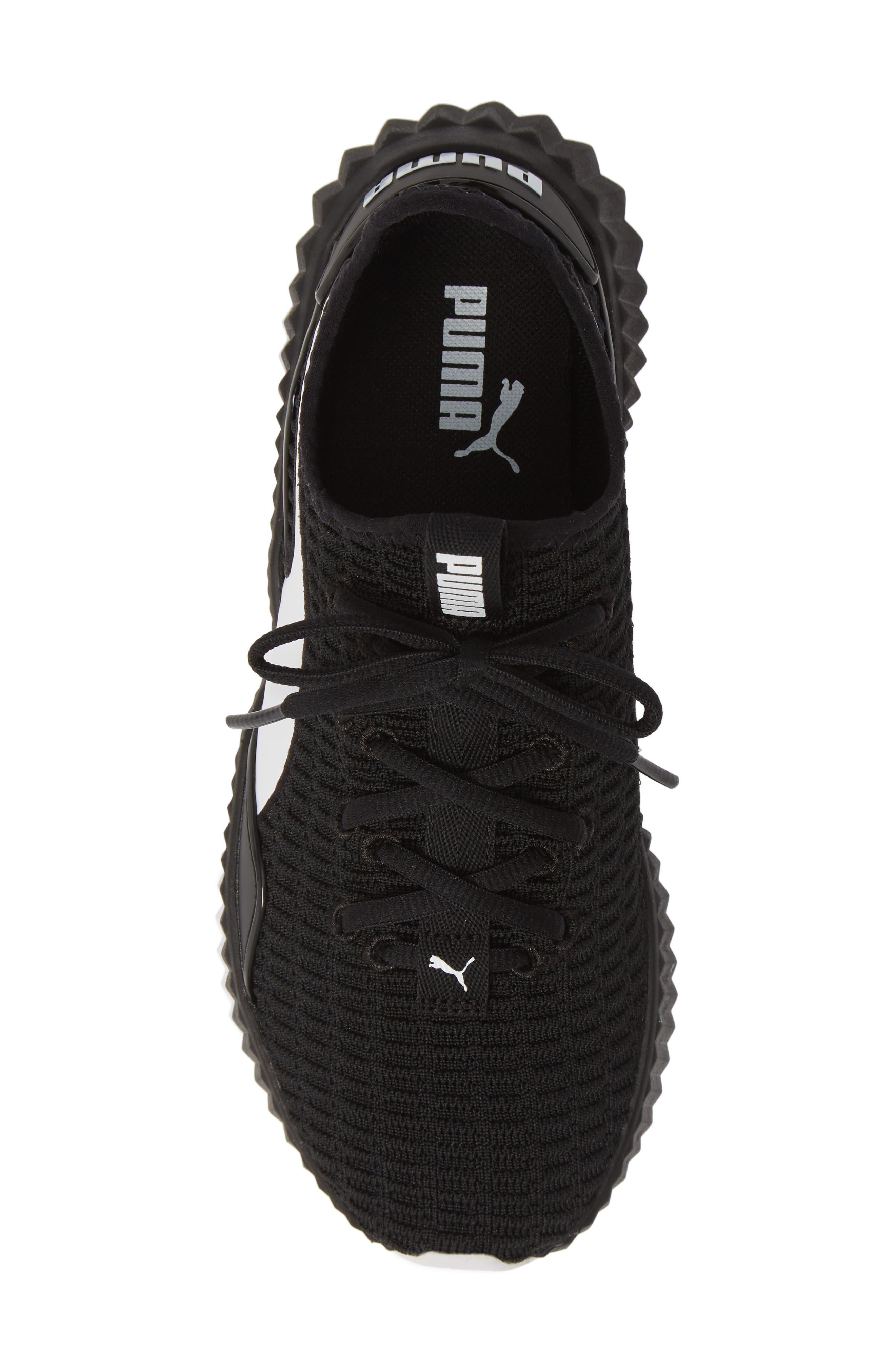 PUMA, Defy Sneaker, Alternate thumbnail 5, color, BLACK/ WHITE