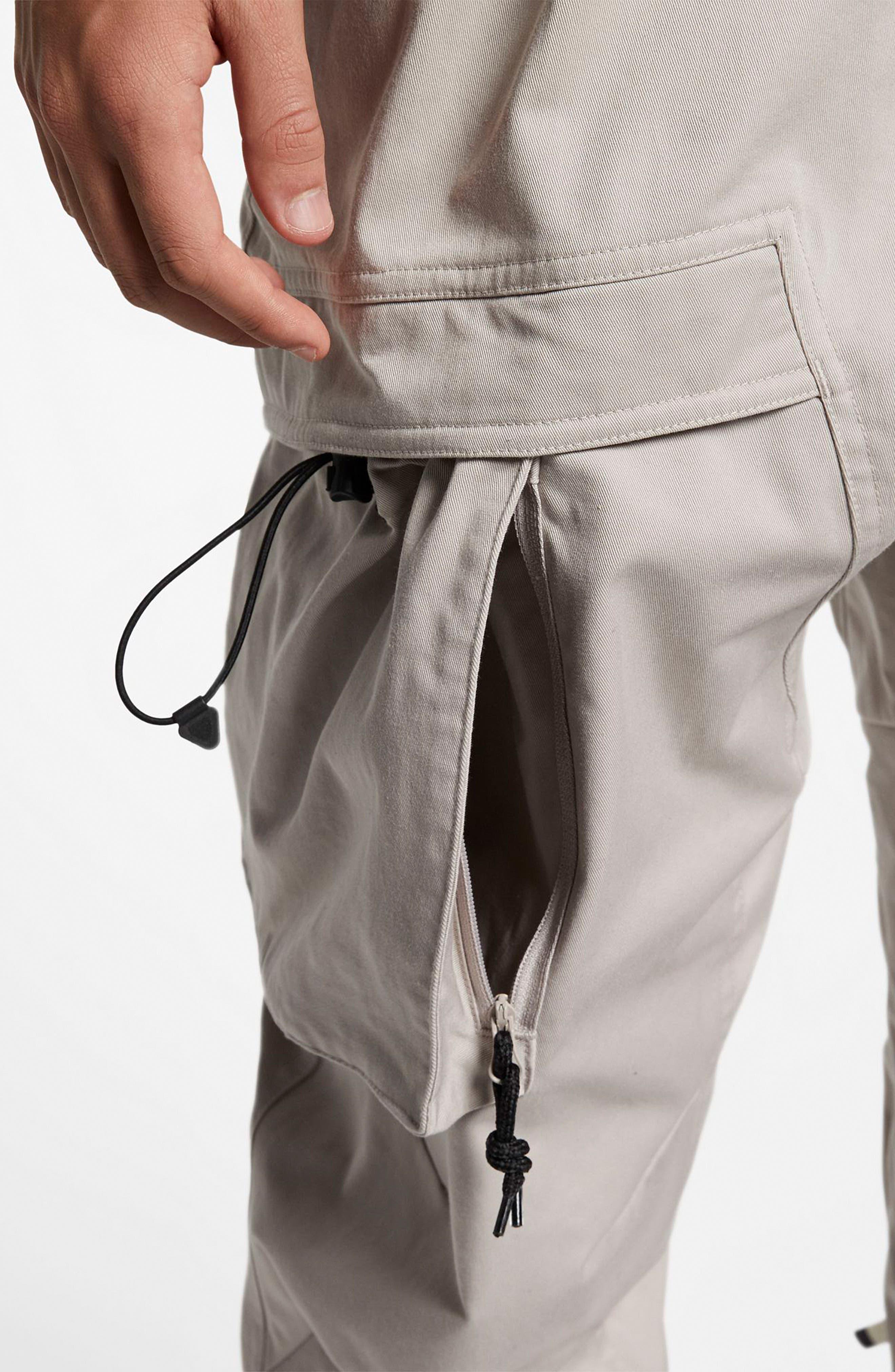 NIKE, ACG Men's Cargo Pants, Alternate thumbnail 7, color, MOON PARTICLE