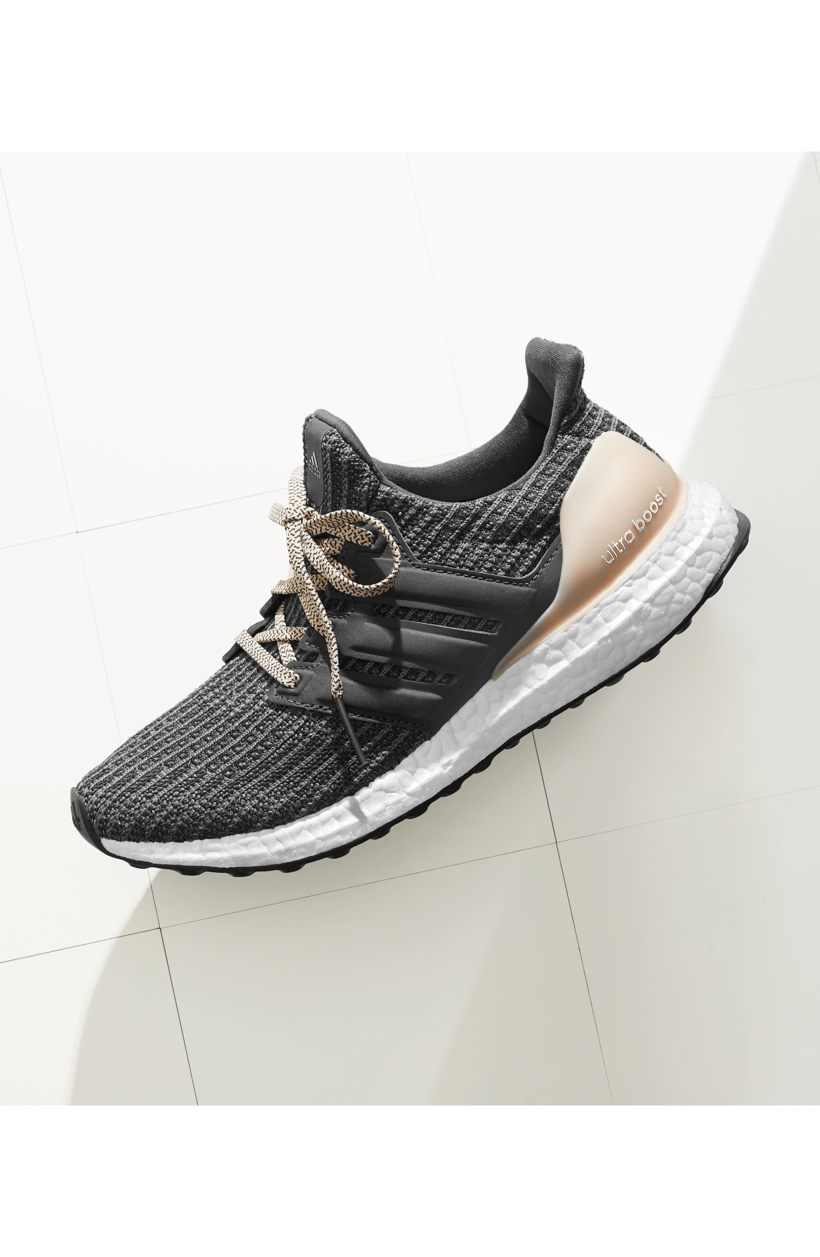ADIDAS, 'UltraBoost' Running Shoe, Alternate thumbnail 12, color, CORE BLACK/ GOLD METALLIC