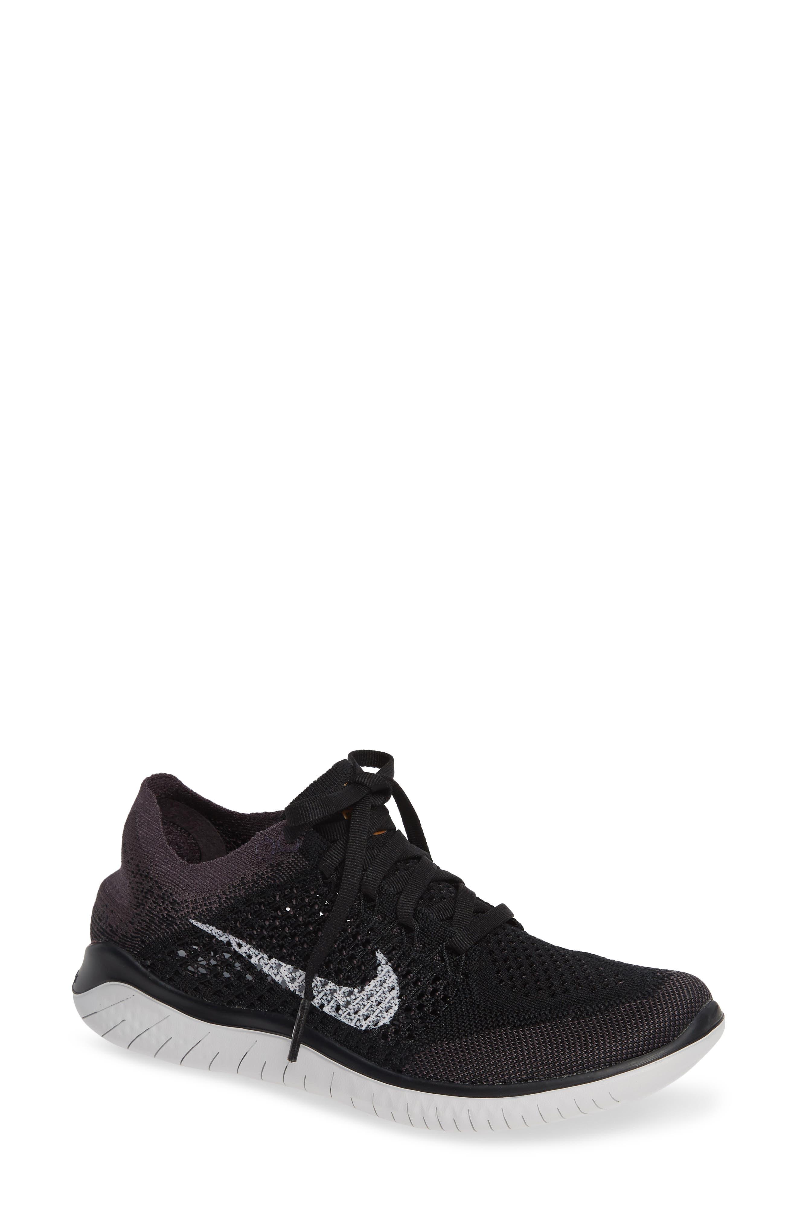 NIKE Free RN Flyknit 2018 Running Shoe, Main, color, BLACK/ VAST GREY/ GOLD