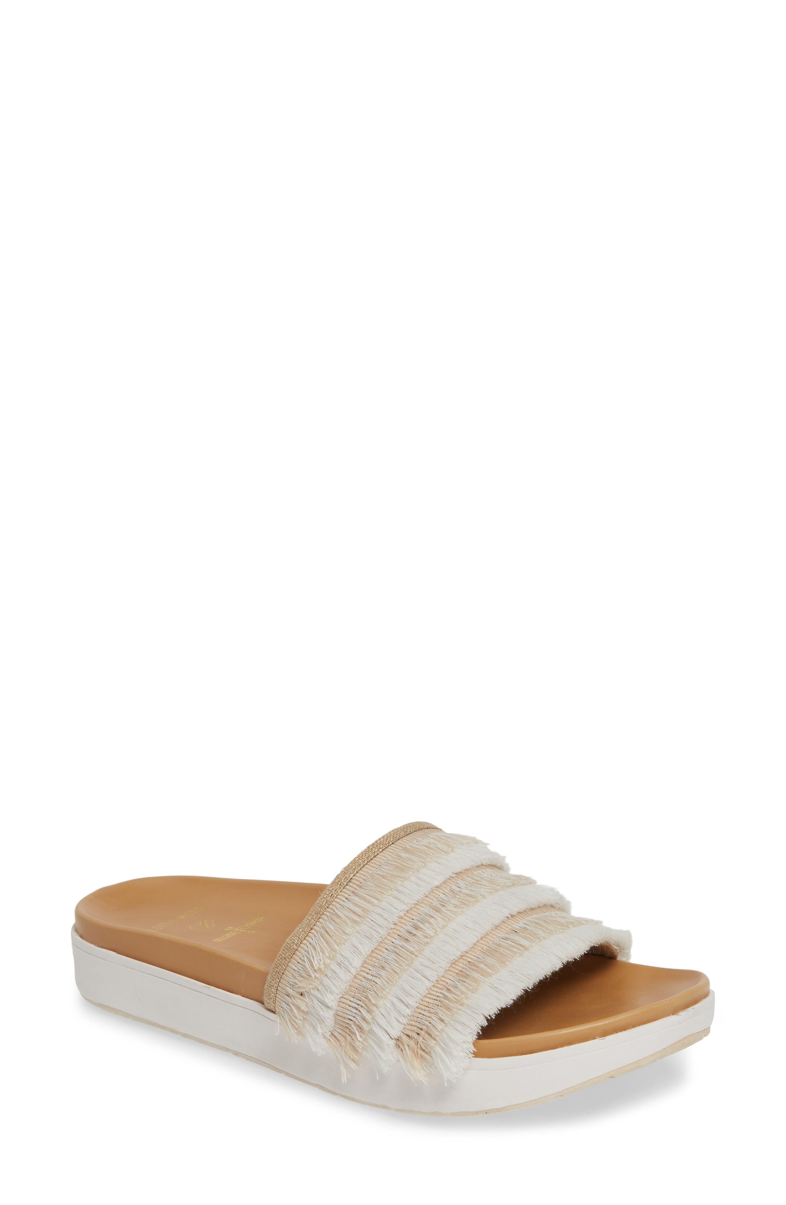 MINNETONKA x Lottie Moss Ashlynn Fringe Slide Sandal, Main, color, TAUPE