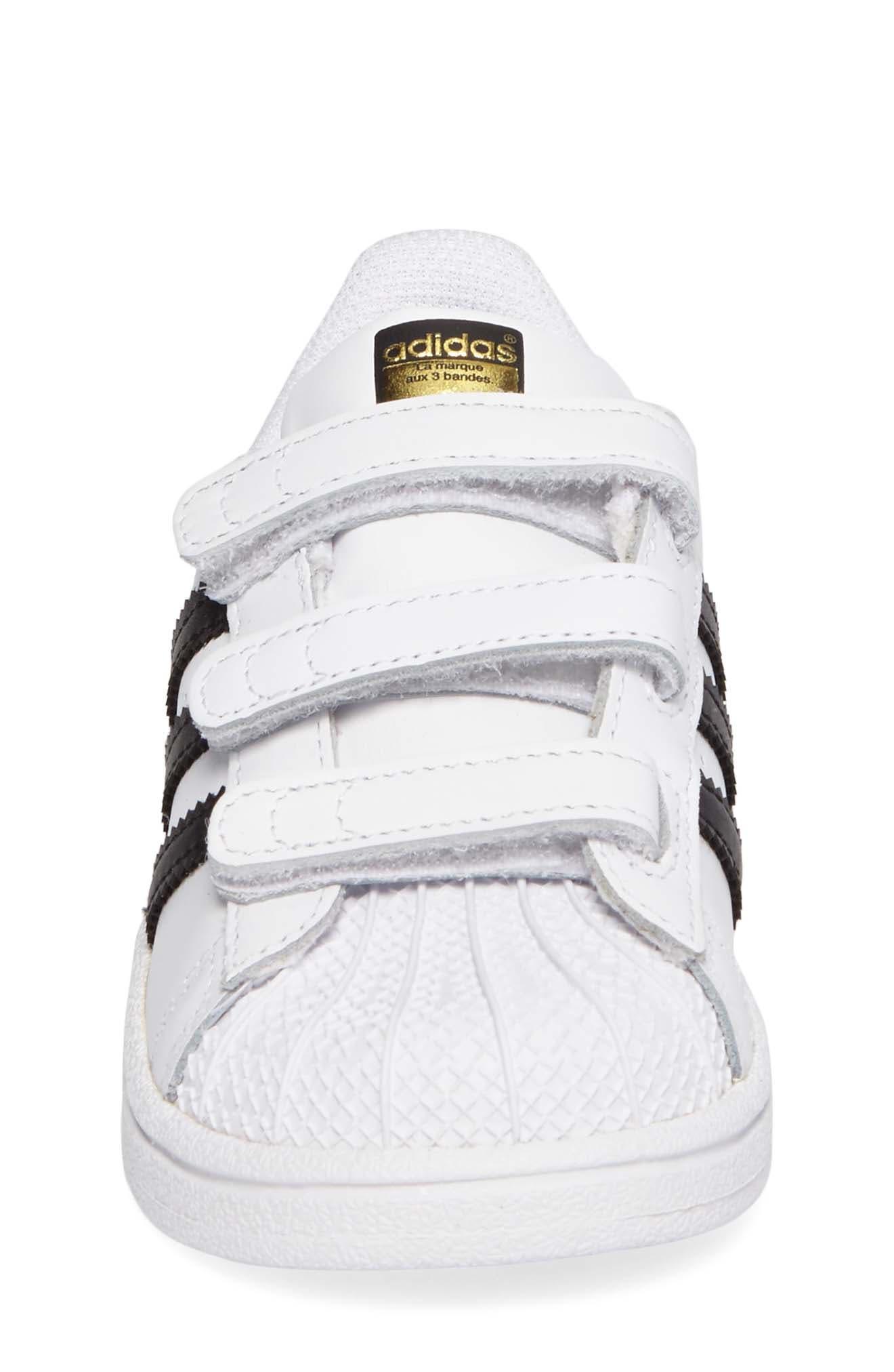 ADIDAS, Superstar Sneaker, Alternate thumbnail 4, color, WHITE/ BLACK/ WHITE