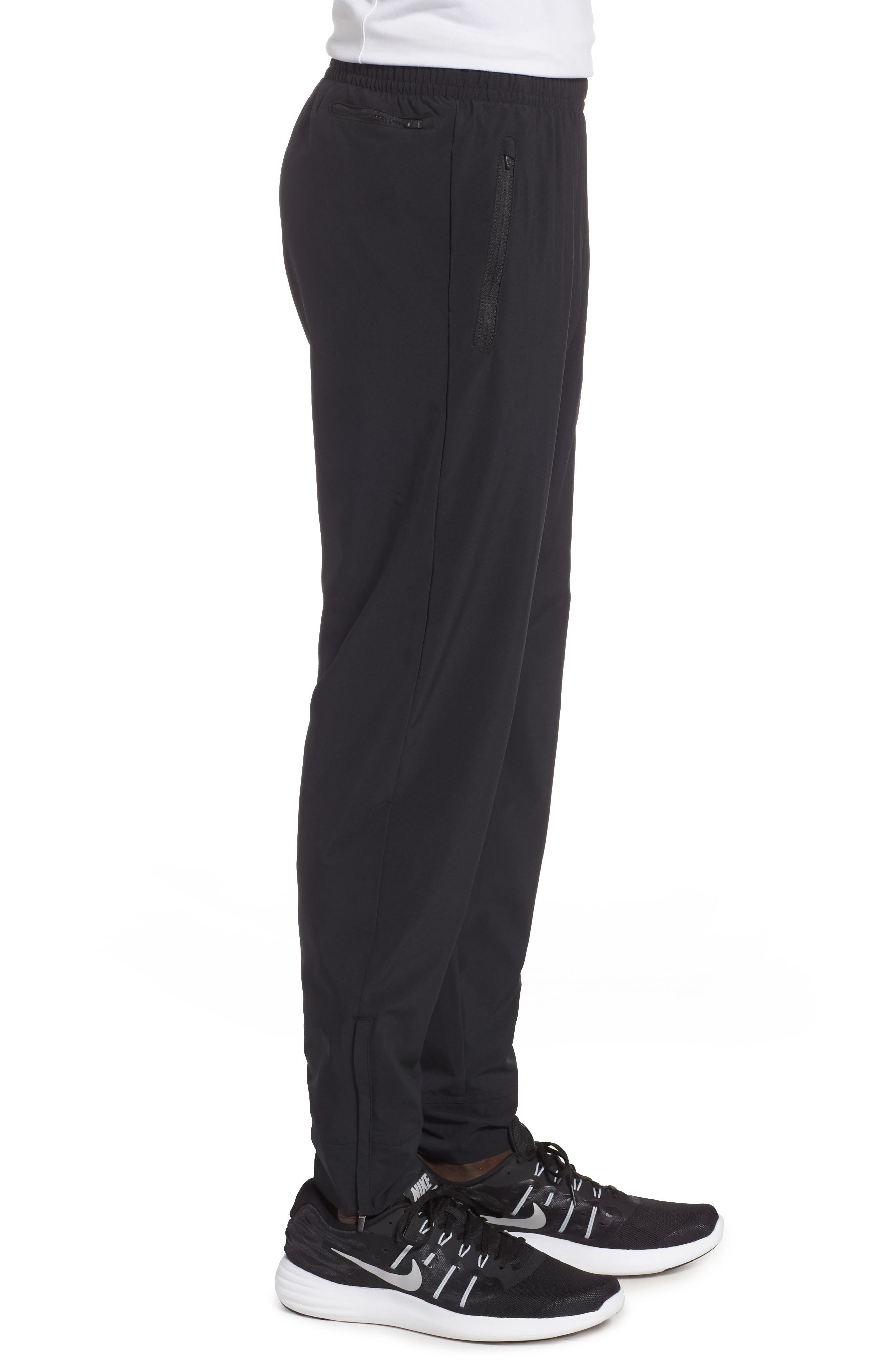 NIKE, Essential Woven Track Pants, Alternate thumbnail 4, color, BLACK