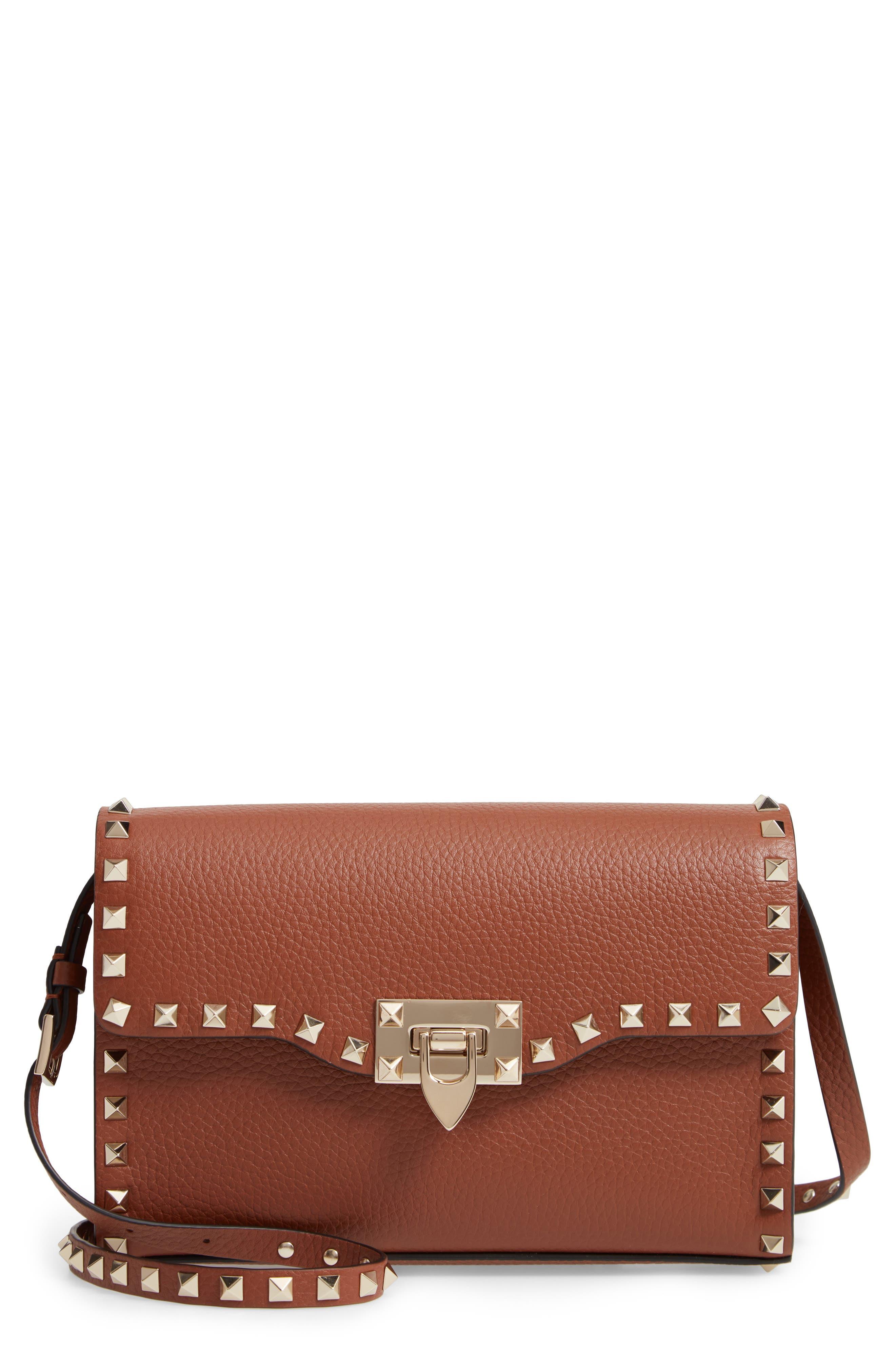 VALENTINO GARAVANI, Medium Rockstud Leather Crossbody Bag, Main thumbnail 1, color, BRIGHT COGNAC