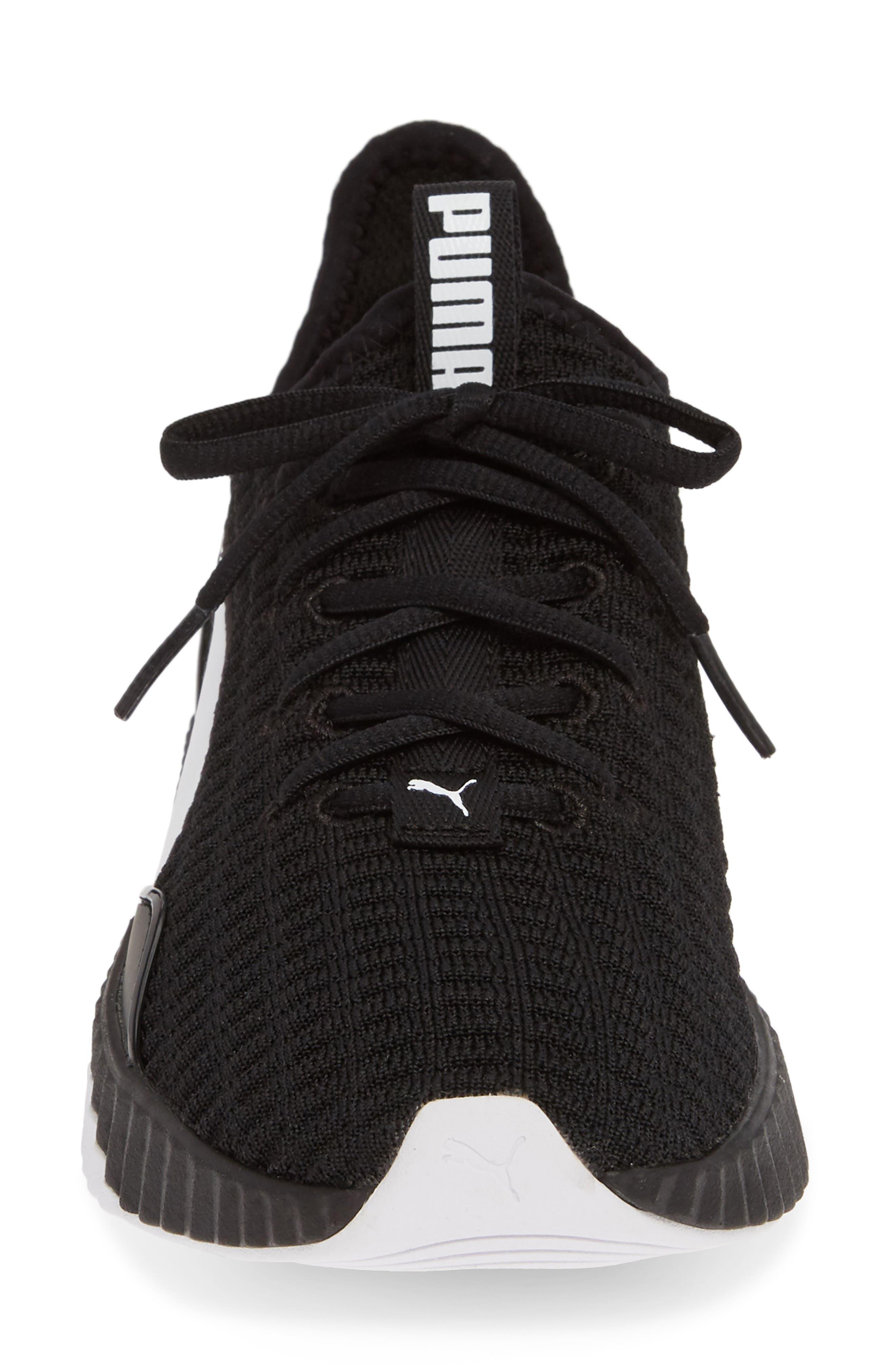 PUMA, Defy Sneaker, Alternate thumbnail 4, color, BLACK/ WHITE