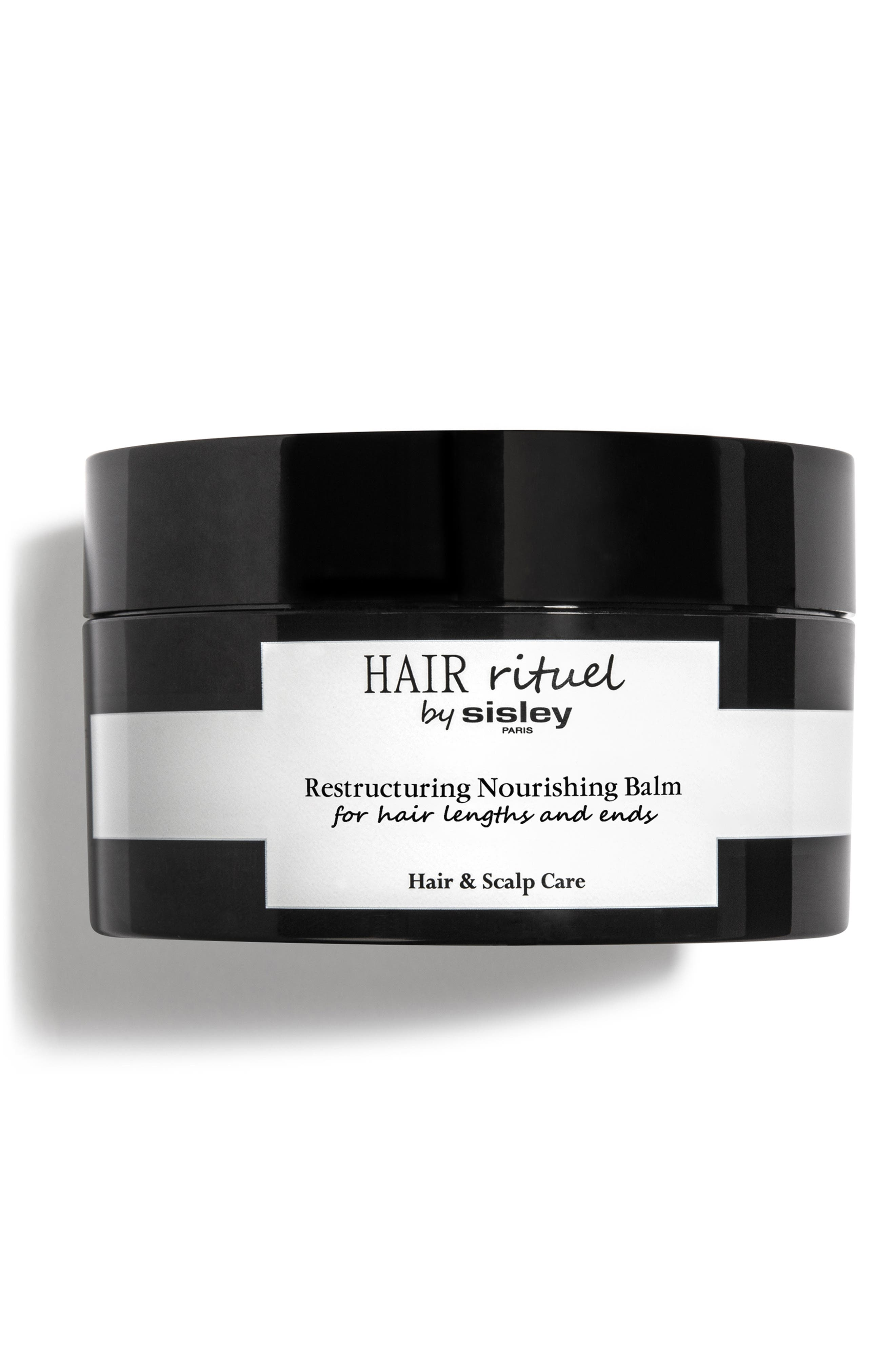 What it is: A pre-shampoo hair treatment that deeply nourishes damaged, dry and brittle hair. What it does: This silky balm is enriched with a precious combination of botanical oils that act on the hair fiber to intensely nourish, restore and restructure hair. It instantly transforms from a balm into an oil for a sensorial experience. How to use: Apply to dry hair once per week. Spread the balm along the lengths and on the ends of hair,