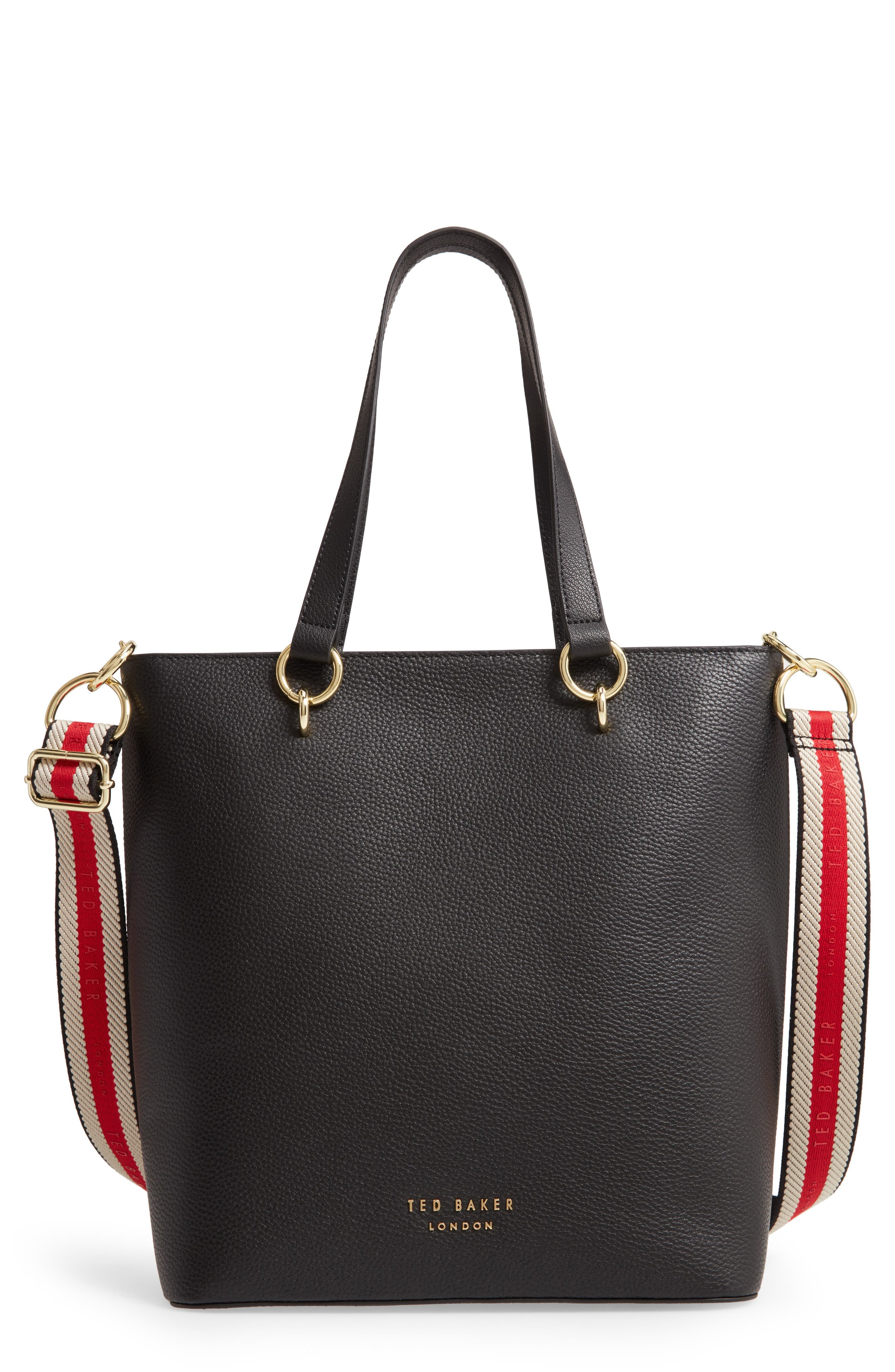This grainy leather tote has two shoulder straps that lie flat on the sides when you mix it up using the sporty striped and branded webbed strap. Style Name: Ted Baker London Amarie Branded Strap Tote. Style Number: 5997123. Available in stores.