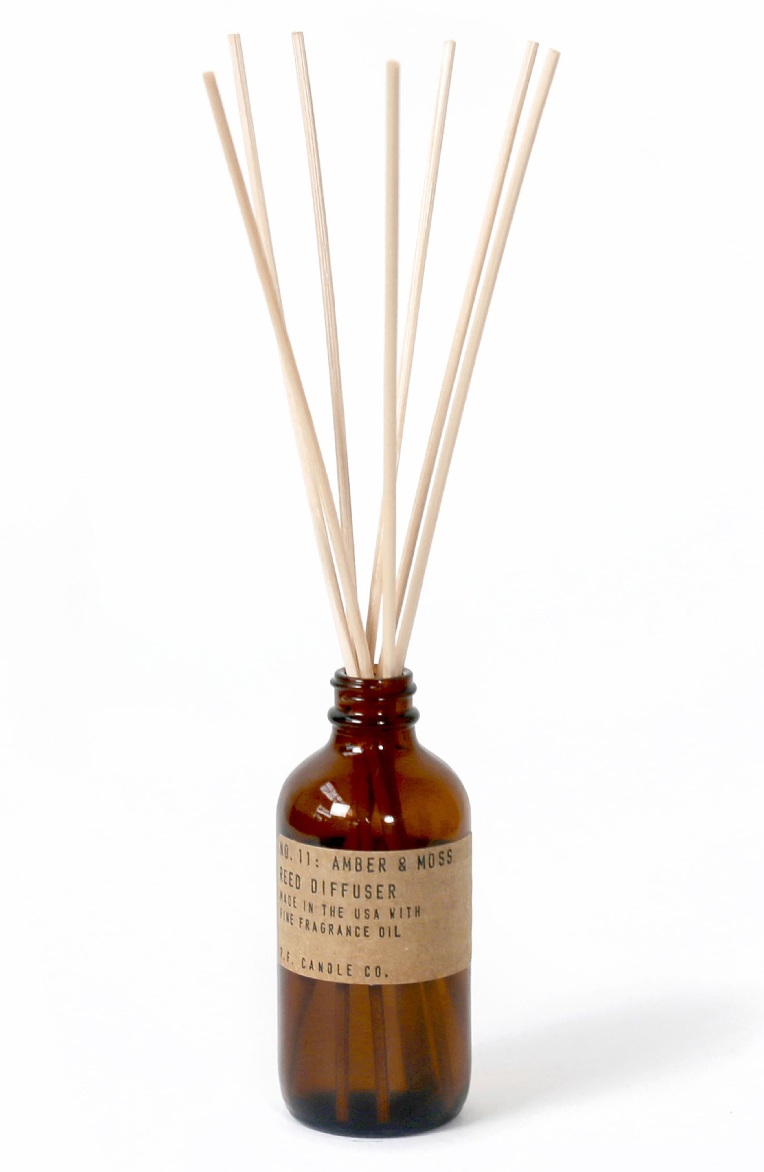 What it is: A reed diffuser presented in an apothecary-inspired amber glass bottle with a signature label and rattan reeds. Fragrance story: This scent makes you think of a weekend in the mountains with the sun gleaming through the canopy. Style: woody, aromatic. Notes:- Top: moss, lavender- Middle: sage, lavandin, orange- Bottom: amber, musk. Style Name:P.f. Candle Co. Reed Diffuser. Style Number: 5922891. Available in stores.
