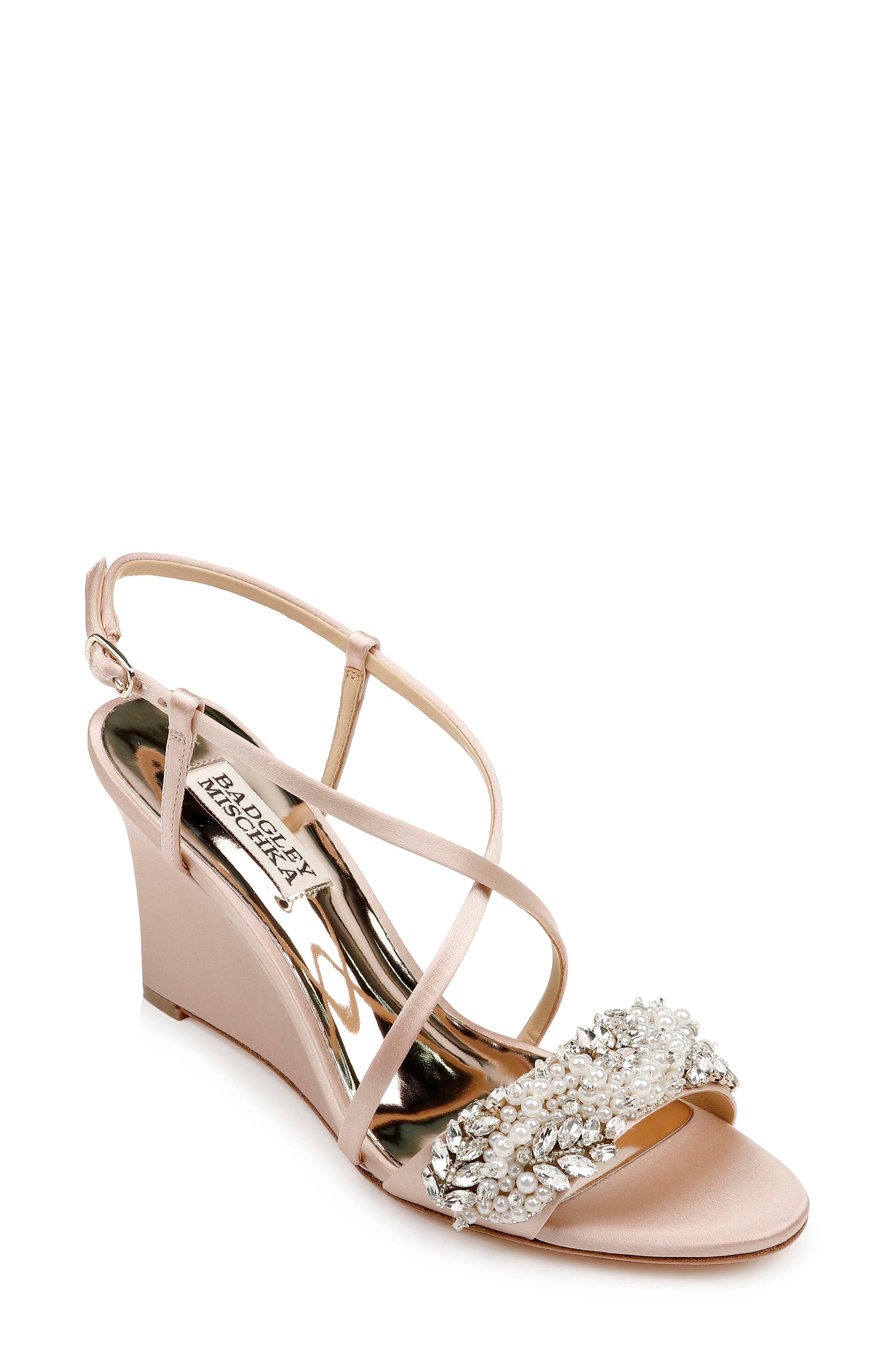 Leaf-shaped crystals and lustrous imitation pearls crown the toe strap of a pretty party sandal lifted by a curved wedge. Style Name: Badgley Mischka Clarisa Embellished Wedge Sandal (Women). Style Number: 5948991. Available in stores.