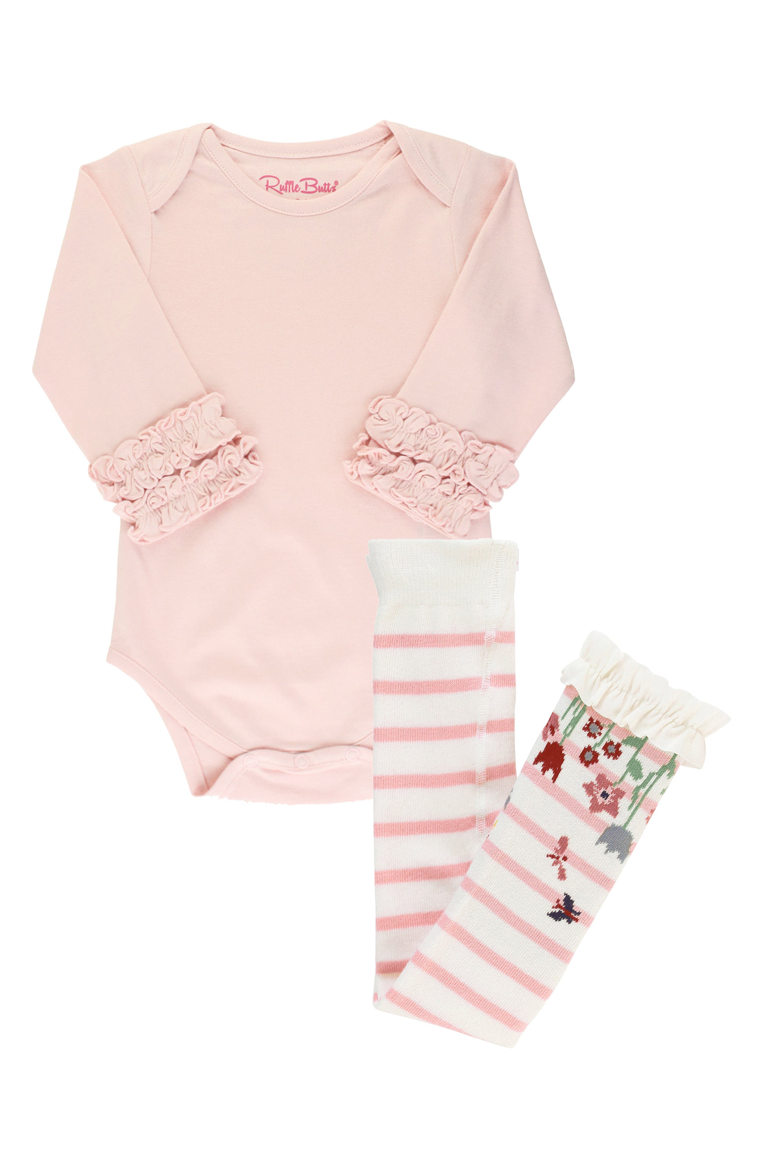 Abundant ruffles add endearing style to a long-sleeve jersey bodysuit that pairs with striped tights for a perfect playtime style. Style Name: Rufflebutts Ballet Pink Bodysuit & Stripe Tights Set (Baby). Style Number: 6115692. Available in stores.
