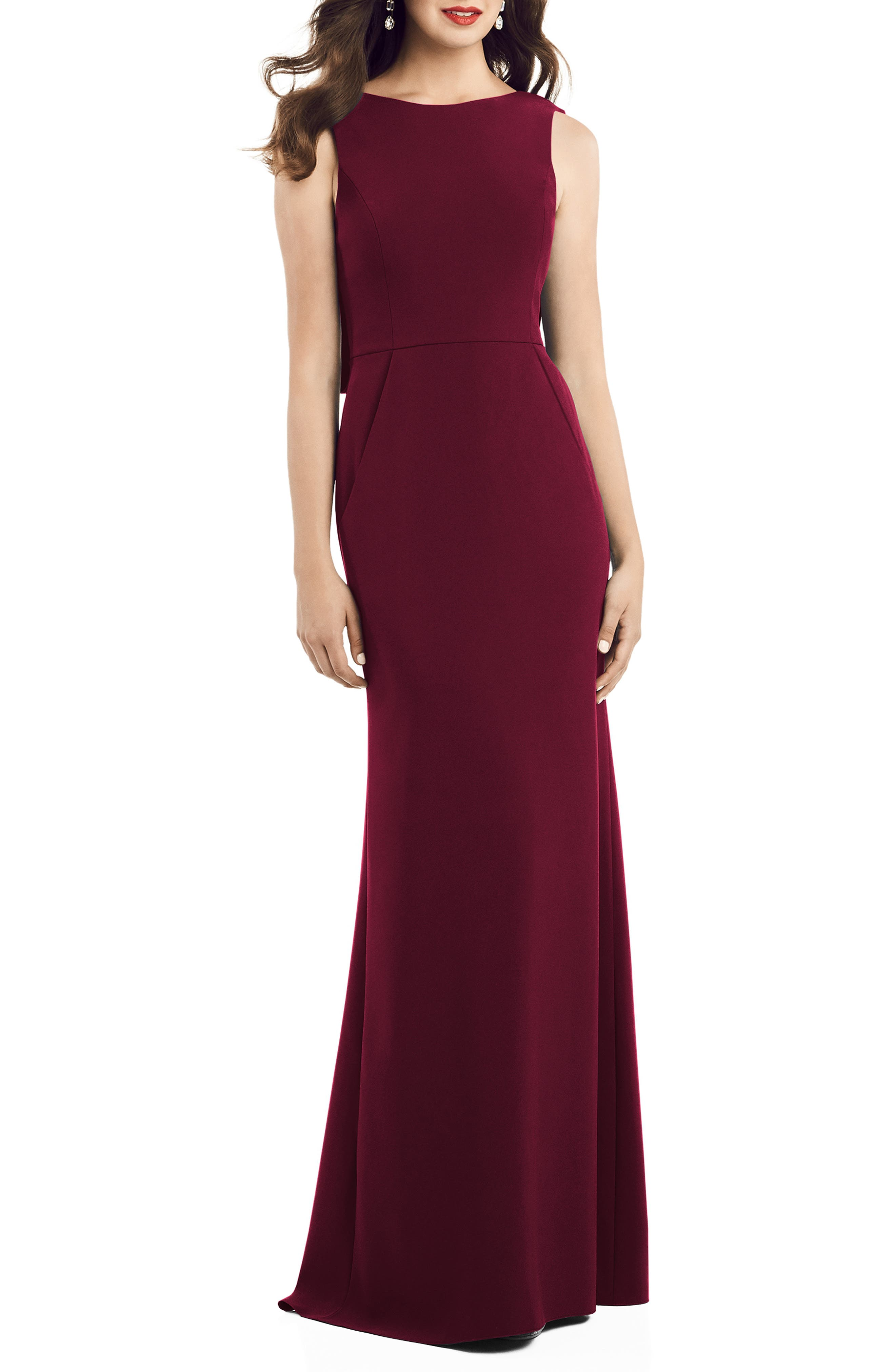 Amazing shape and a flared hem trumpet your entrance in this crepe gown that will not disappoint with a low V-back with draped panels. Style Name: Dessy Collection Crepe Trumpet Gown. Style Number: 6003841. Available in stores.