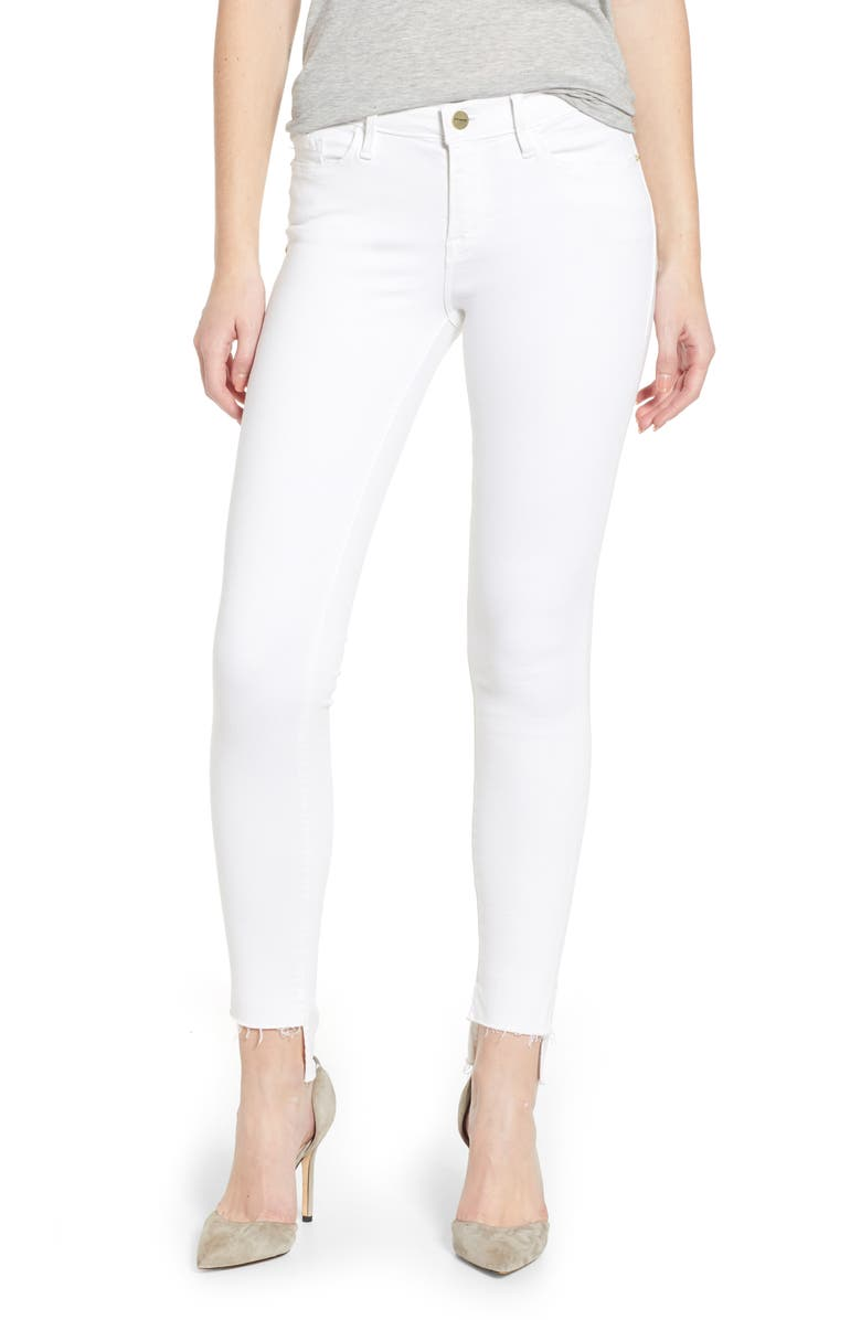 FRAME Le Skinny de Jeanne Raw Stagger Hem Jeans, Main, color, 100