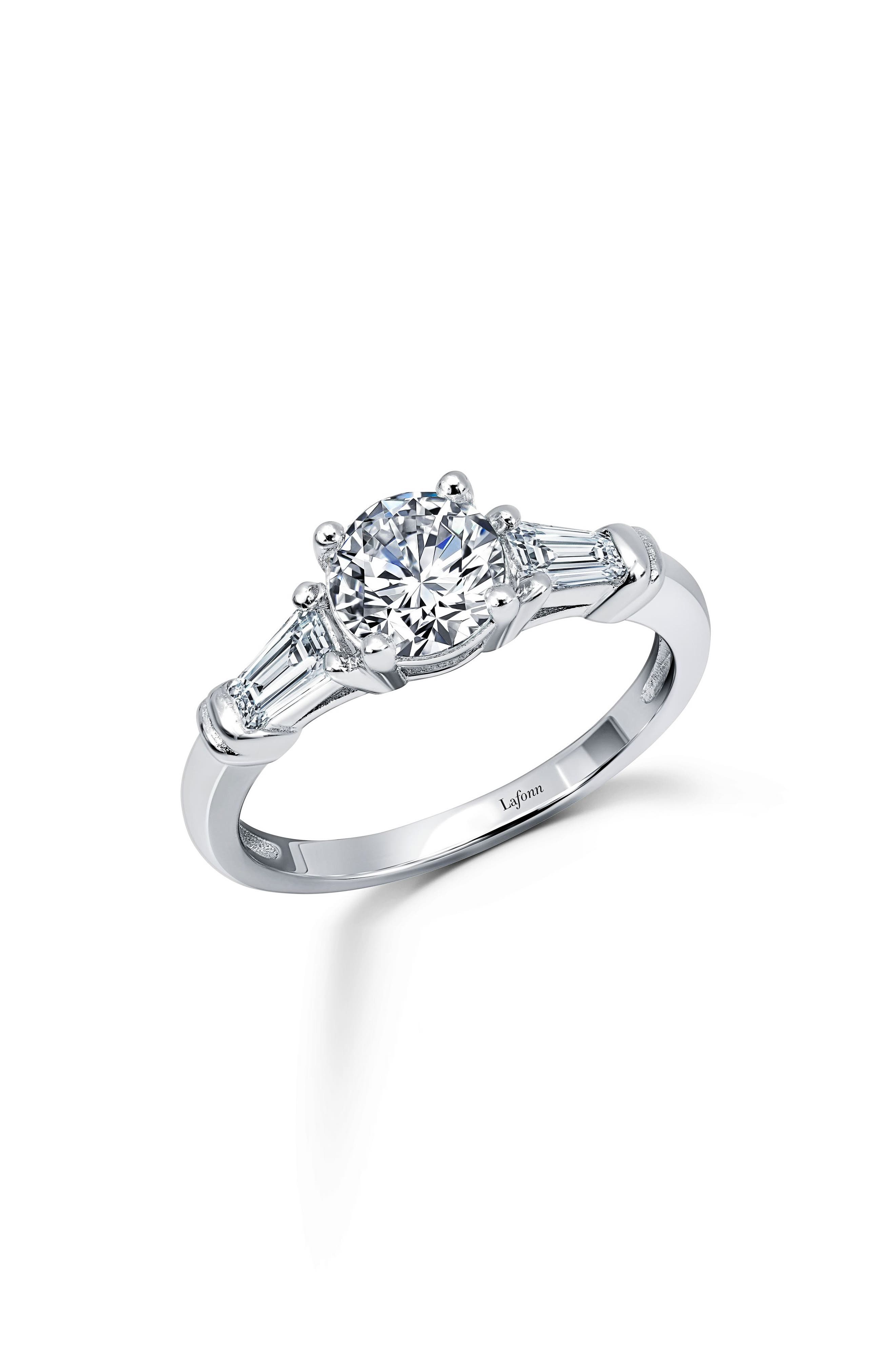This sparkling three-stone ring features a brilliant round center stone and two faceted baguettes in a timelessly elegant polished setting. Style Name: Lafonn Three Stone Ring. Style Number: 6183378. Available in stores.