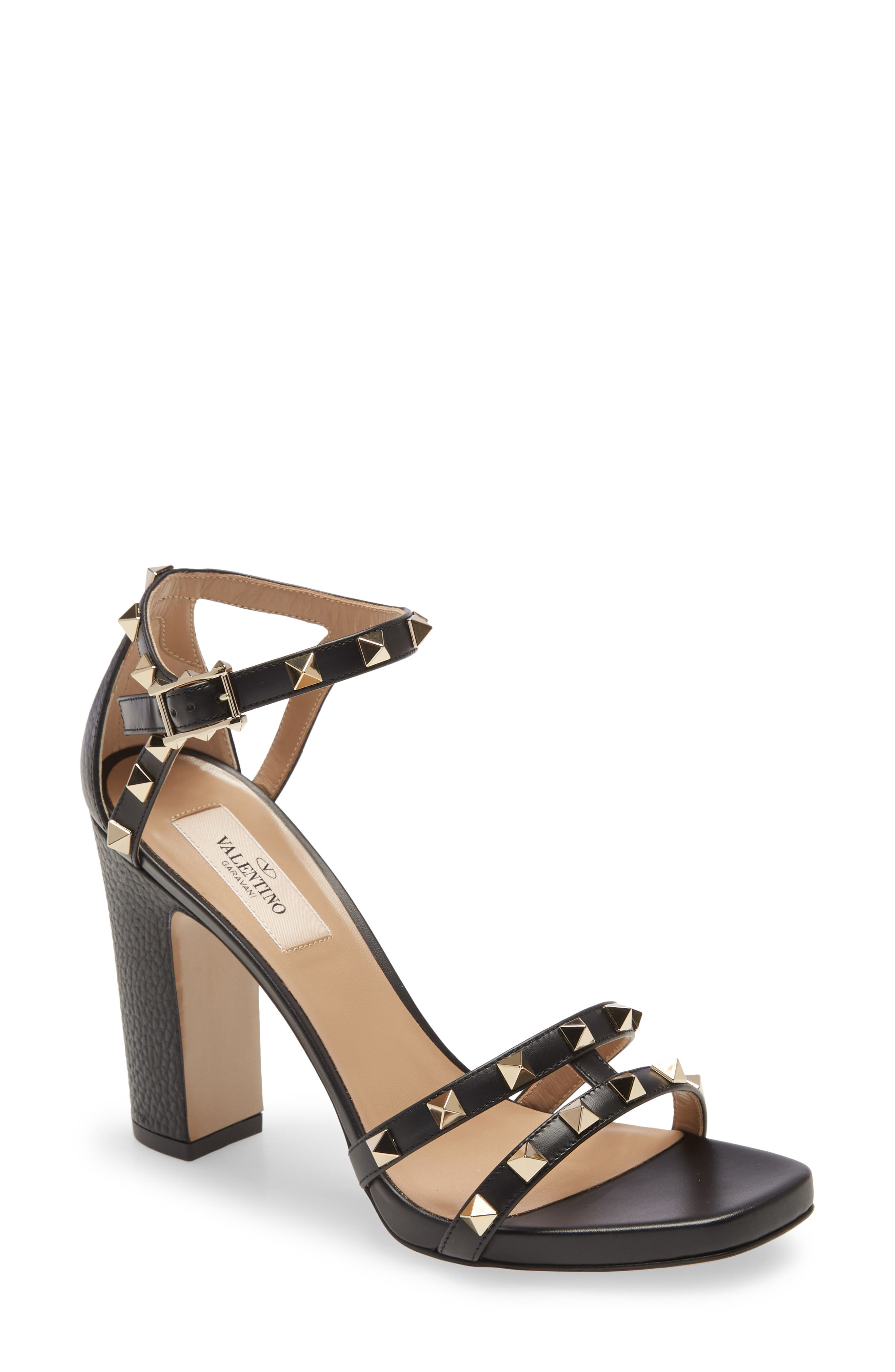 Gleaming pyramid studs punctuate the strappy geometry of a chic Italian sandal elevated by a wrapped block heel. Style Name: Valentino Rockstud Strappy Block Heel Sandal (Women). Style Number: 5970707. Available in stores.