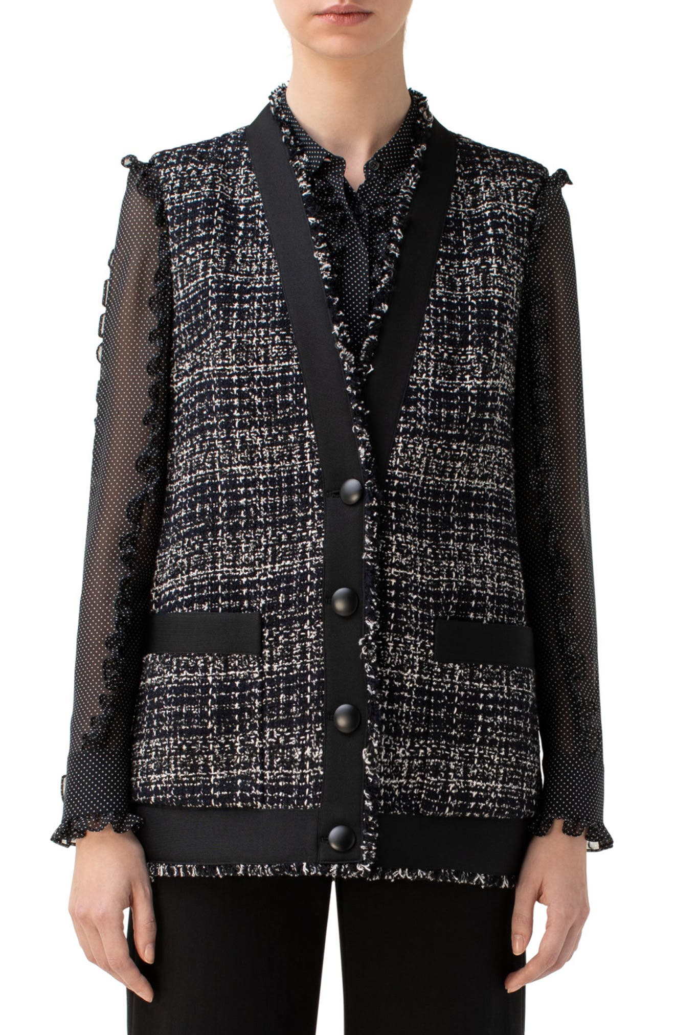 Fringed trim, solid black accents and smooth buttons enhance the textural dimension of this Italian cotton-blend tweed vest. Style Name: Akris Punto Tweed Vest. Style Number: 5999710. Available in stores.