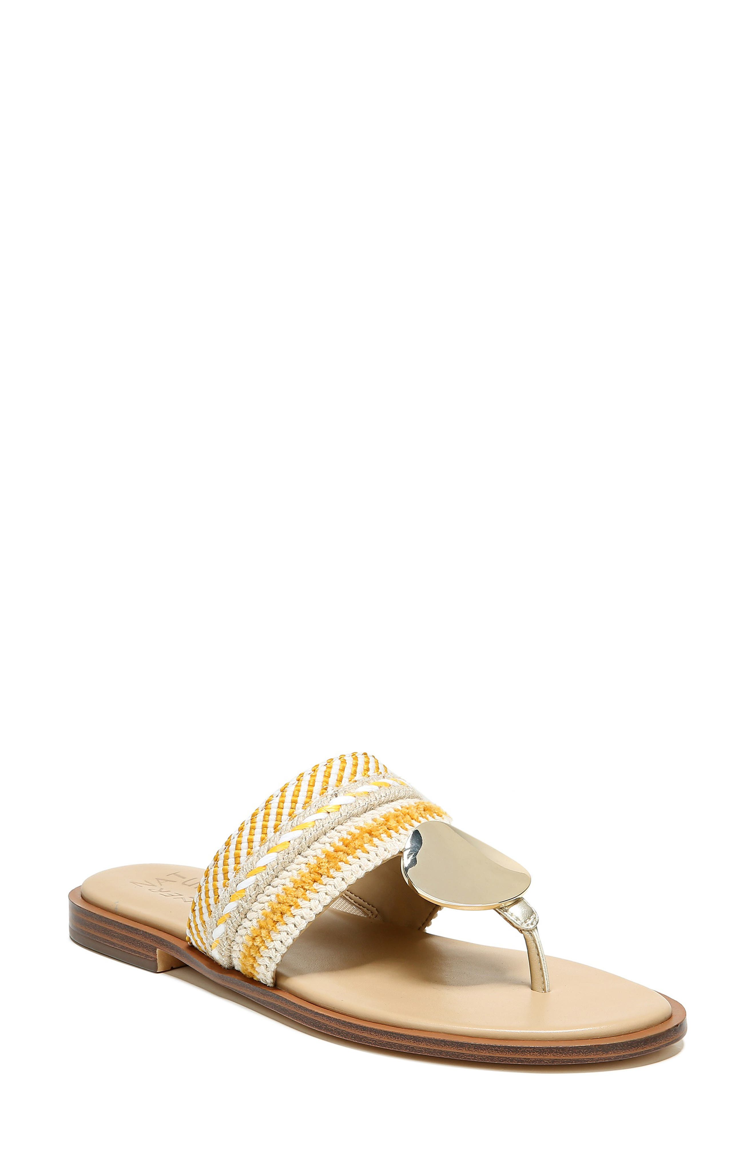 This comfortable thong-strap slide on a Contour Plus foam-cushioned insole is dressed up with a shimmering medallion and your choice of vibrant textures. Style Name: Naturalizer Frankie Sandal (Women). Style Number: 6015155. Available in stores.