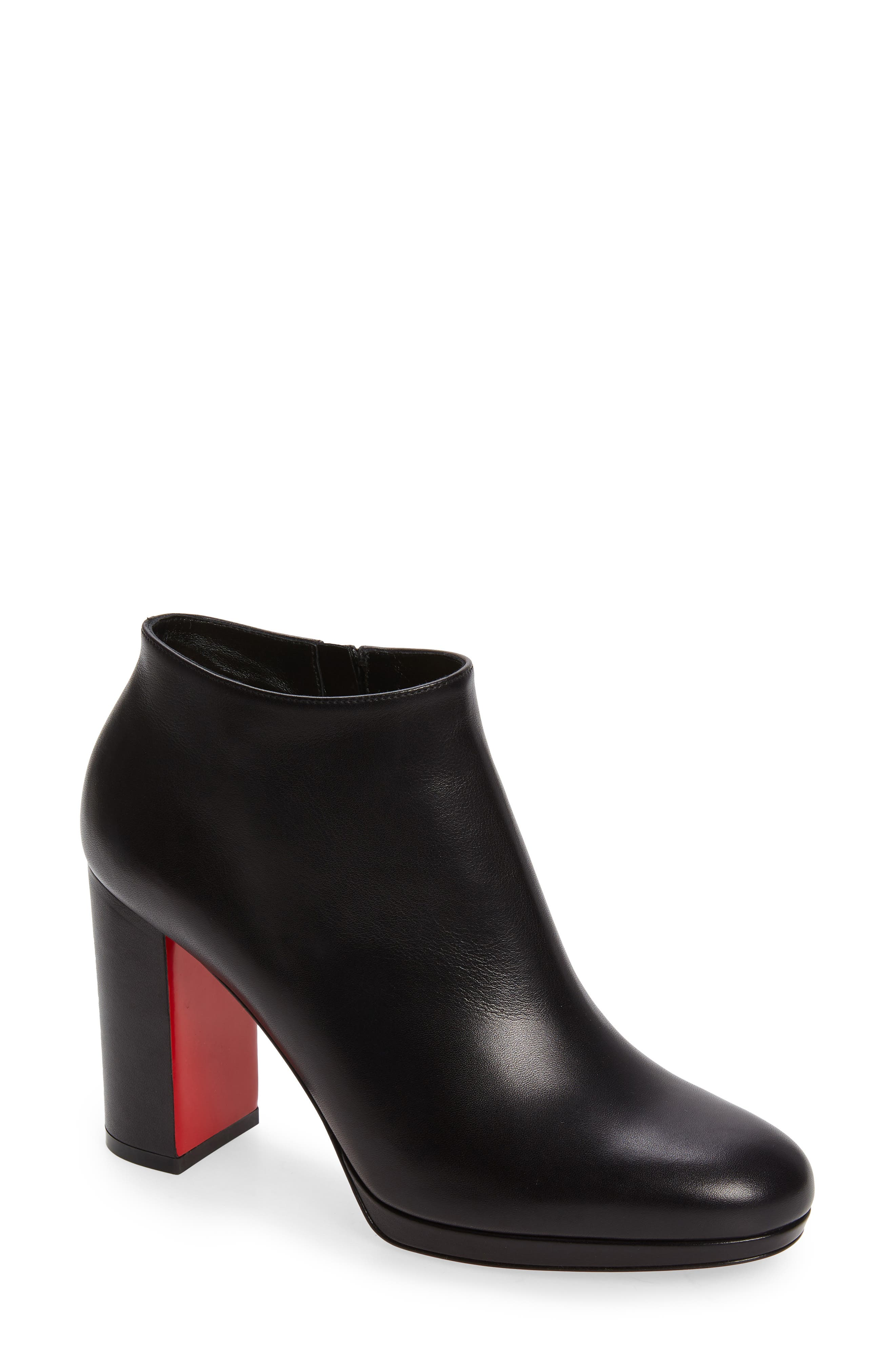A stunning suede bootie with a low topline and tall block heel flashes Louboutin glam with every step on the red sole. Style Name: Christian Louboutin Pastuer Block Heel Bootie (Women). Style Number: 6005822. Available in stores.