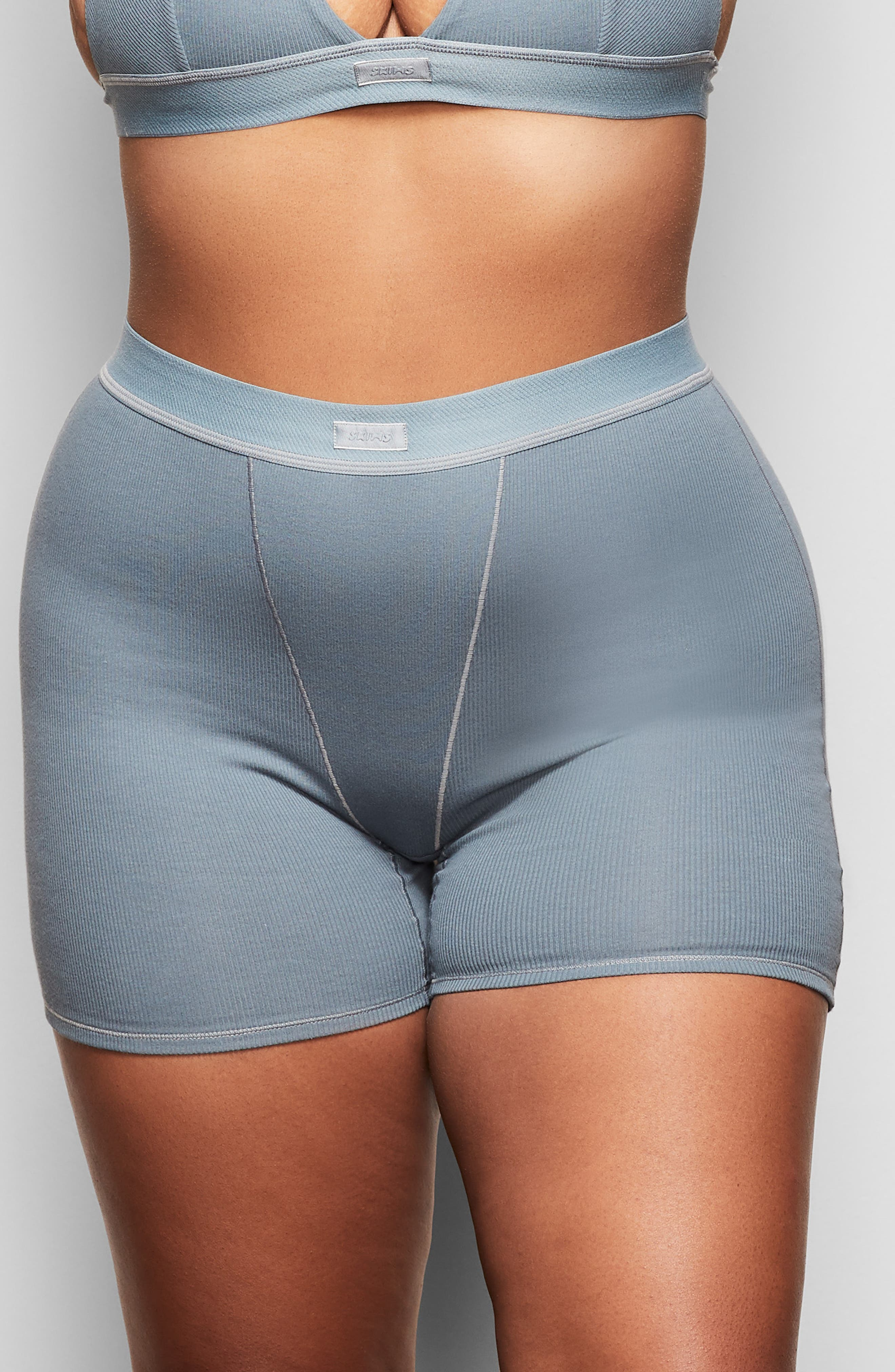 Enjoy the look of your boyfriend\\\'s boxers while retaining the breathability of stretch cotton with this option from Kim Kardashian West\\\'s SKIMS. Available in a range of five complementary colors, this comfortable style that exudes a sporty look with front-fly stitching and soft ribbing, is destined to be a part of your regular rotation. Style Name: Skims Cotton Rib Boxers (Regular & Plus Size). Style Number: 6016010. Available in stores.