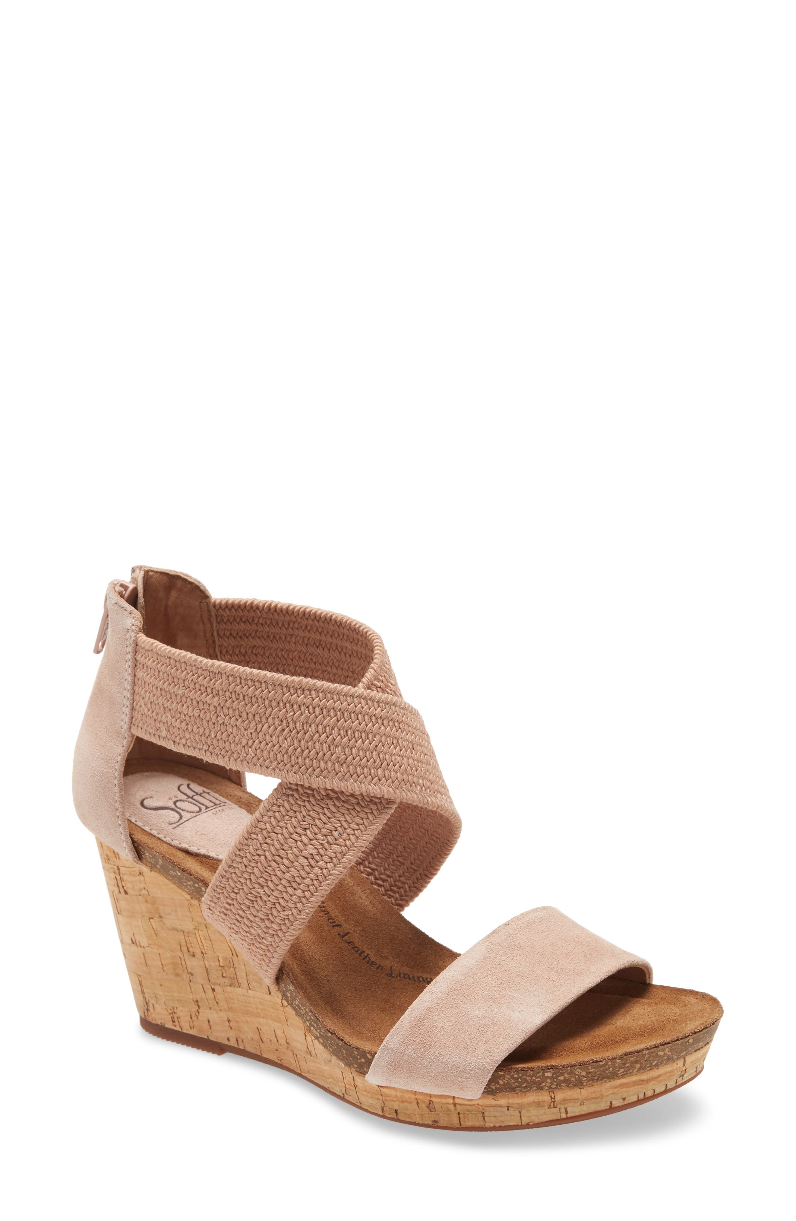 Crossed elastic straps at the inset and a back zip closure stylishly secure this wedge sandal that features a plush, sink-in footbed for all-day comfort. Style Name: Sofft Chalette Cork Wedge Sandal (Women). Style Number: 5993837 1. Available in stores.