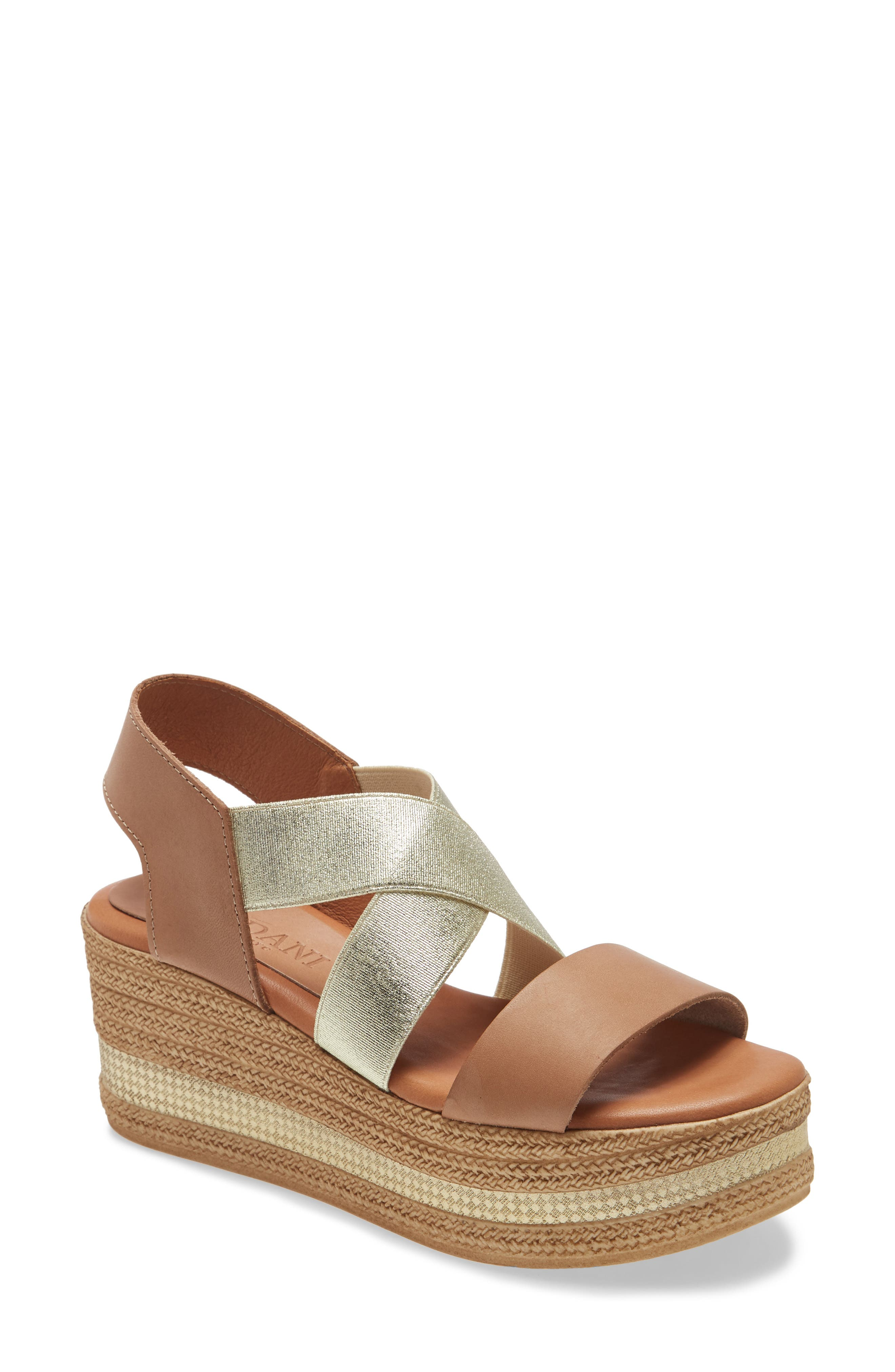 Crisscrossed elastic straps perfect the fit of a plushly cushioned sandal lifted by a textured platform wedge ringed with a metallic accent. Style Name: Cordani Barnaby Wedge Sandal (Women). Style Number: 5789042 1. Available in stores.