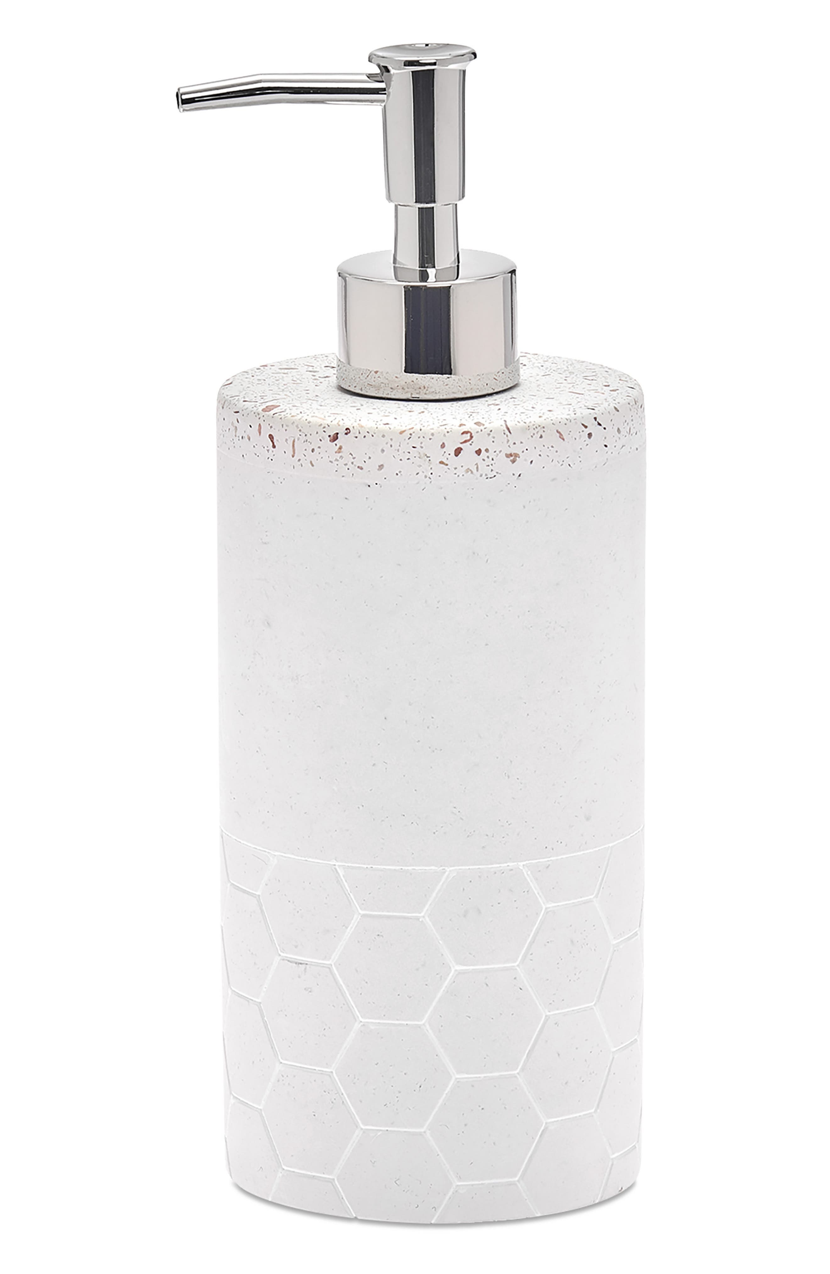 Terrazzo pebbles bring earthy texture and color to a striking cement lotion dispenser that will instantly elevate your bathroom decor. Style Name: UGG Lotion Dispenser. Style Number: 6052086. Available in stores.