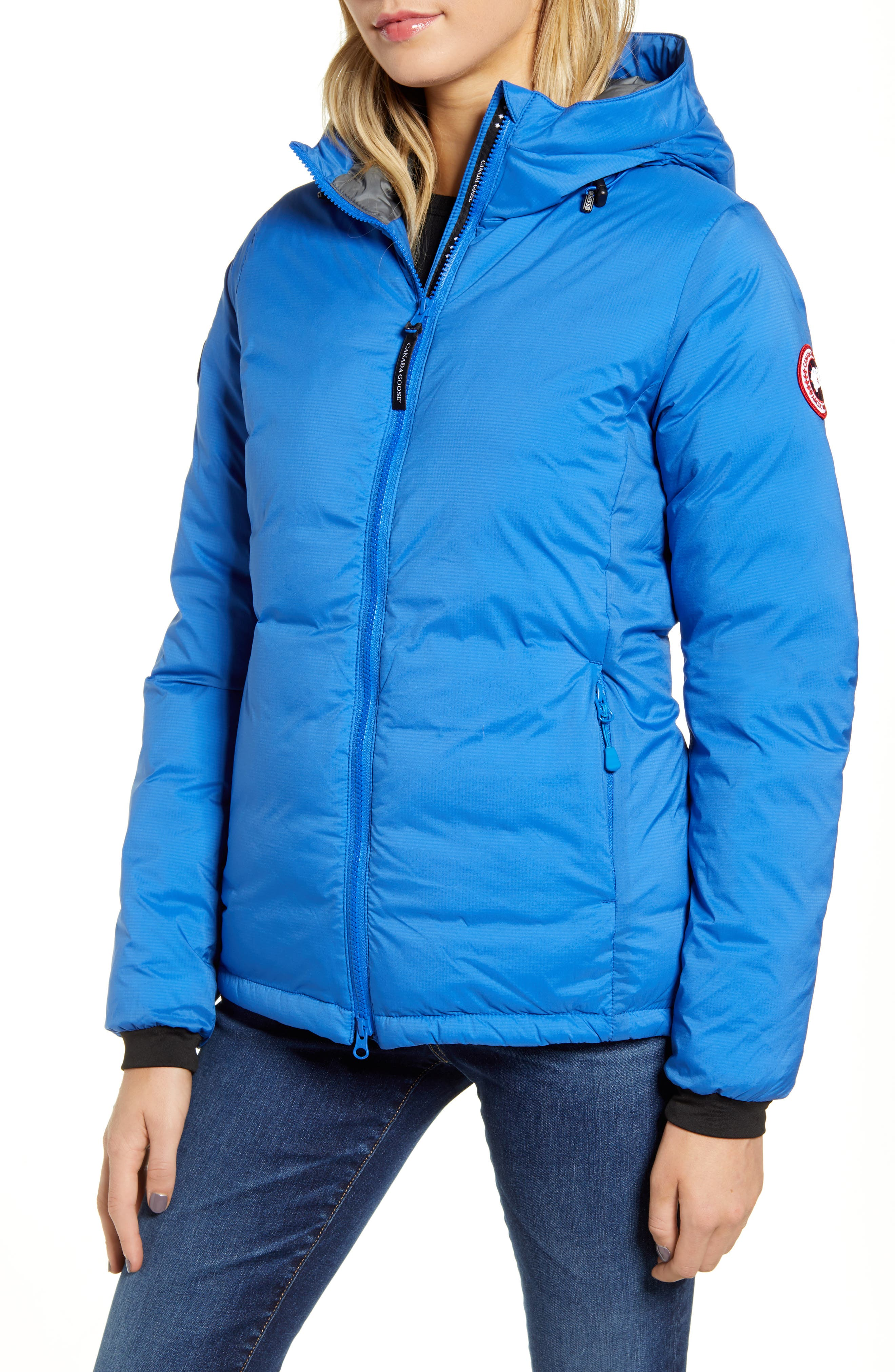 Ideal for backcountry activities and lightweight packing, a warm, wind-proof down jacket compresses to almost nothing for easy storage and portability. A drop-tail hem gives more coverage while its inner drawcord traps in the heat. Something else to warm your heart: purchasing this jacket helps support the efforts of Polar Bears International. Style Name: Canada Goose Pbi Camp Down Hoodie. Style Number: 5874385. Available in stores.