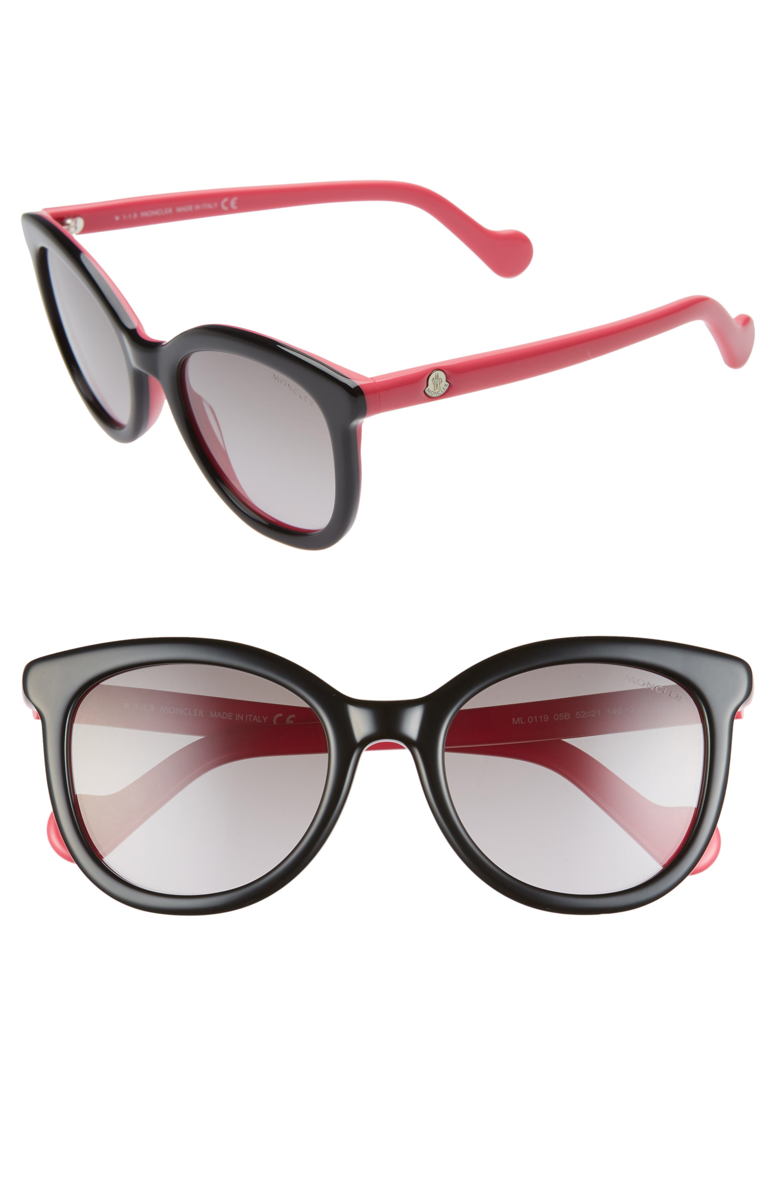 Rounded lenses with flared frames add a hint of mod, cat-eye-inspired attitude to Italian-crafted shades featuring logo-detailed temples. Style Name: Moncler 52mm Sunglasses. Style Number: 5941209. Available in stores.