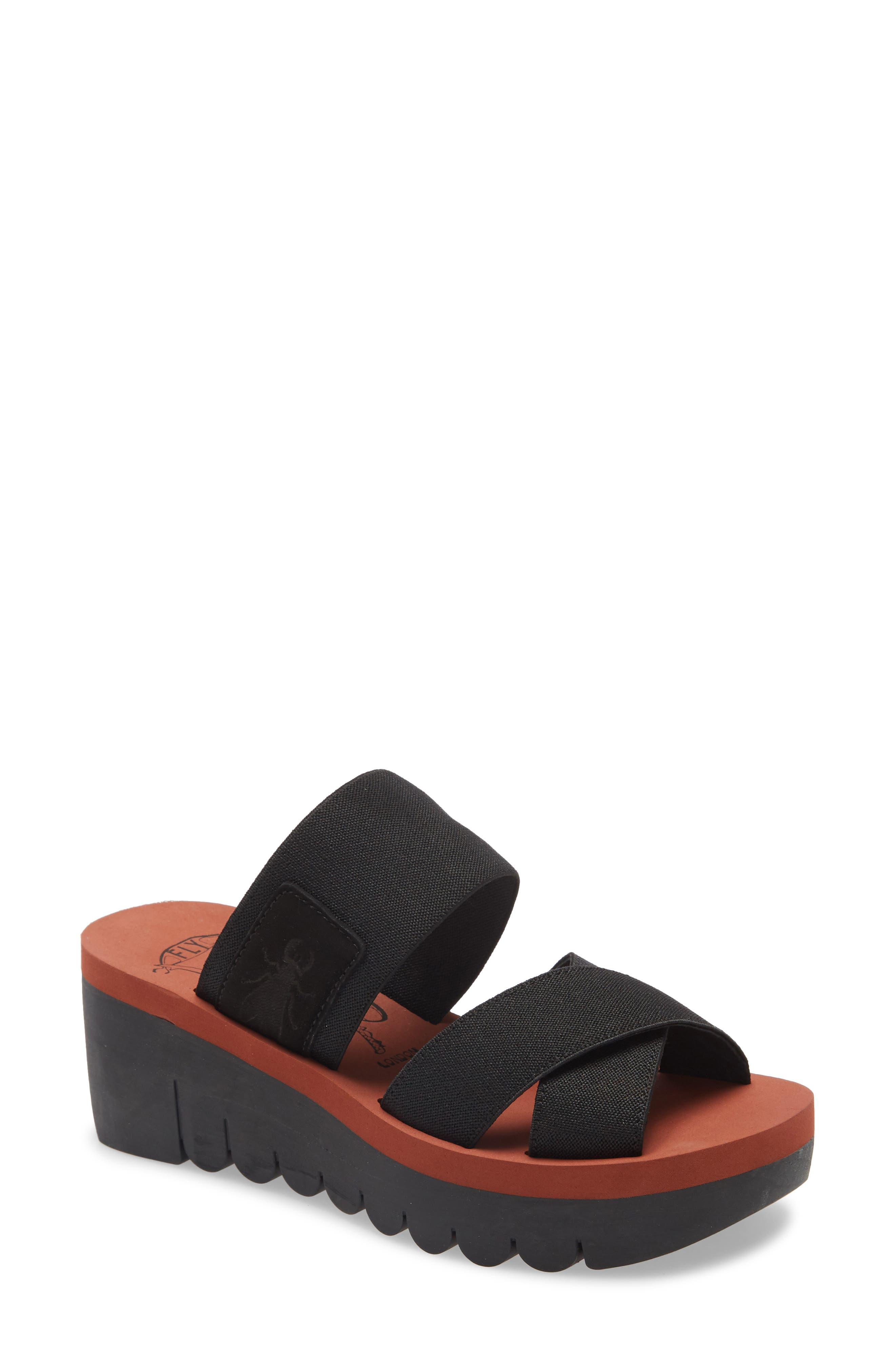 Wide canvas straps top a cushy, comfortable slide sandal lifted by a thick, sporty looking wedge and platform. Style Name: Fly London Yabo Platform Slide Sandal (Women). Style Number: 6002338 1. Available in stores.