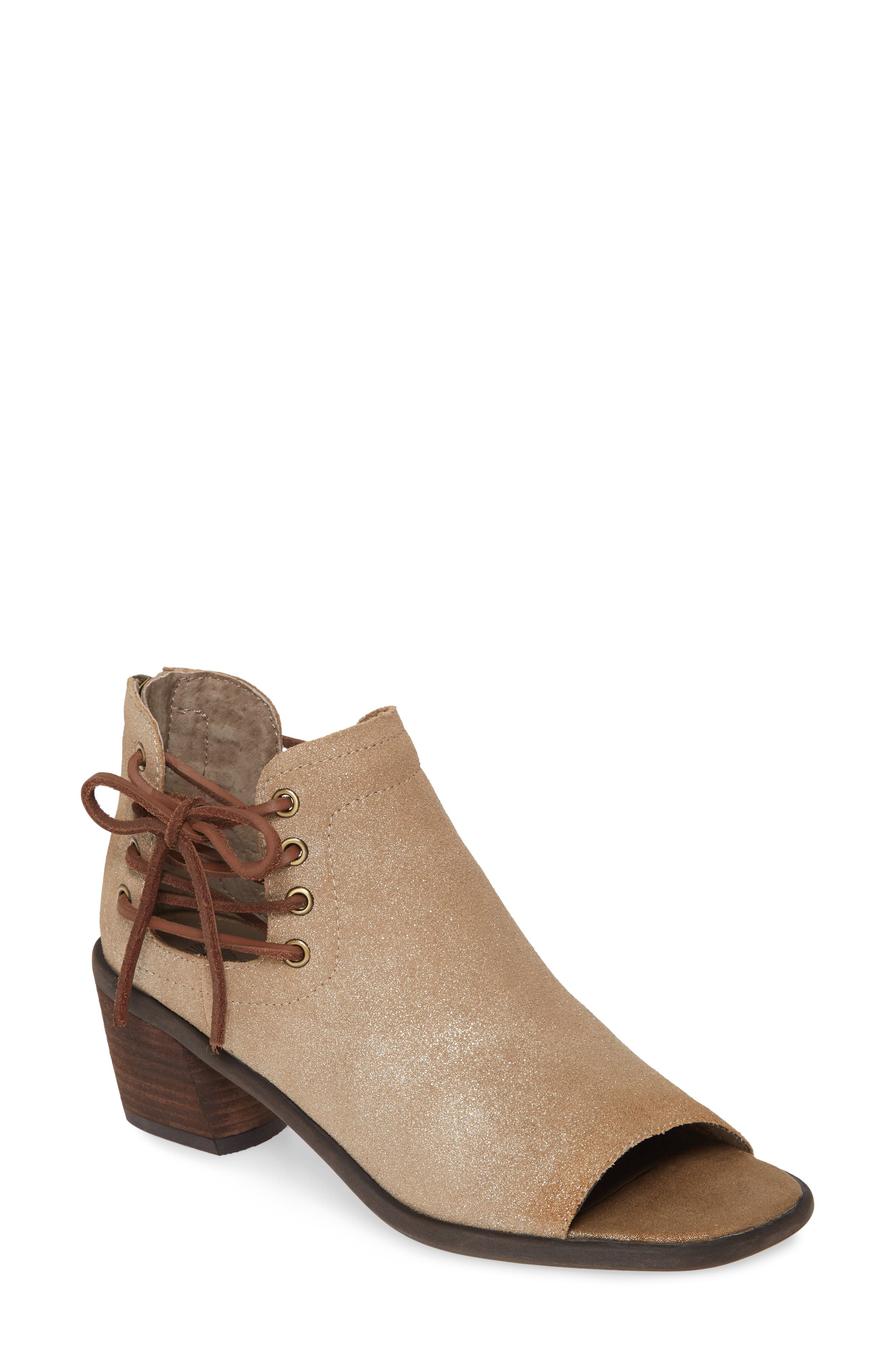 Raw leather laces are woven up the notched sides of this open-toe boot crafted from smooth leather and fit with a cushy, memory foam footbed. Style Name: Otbt Prairie Open Toe Boot (Women). Style Number: 5862201 1. Available in stores.