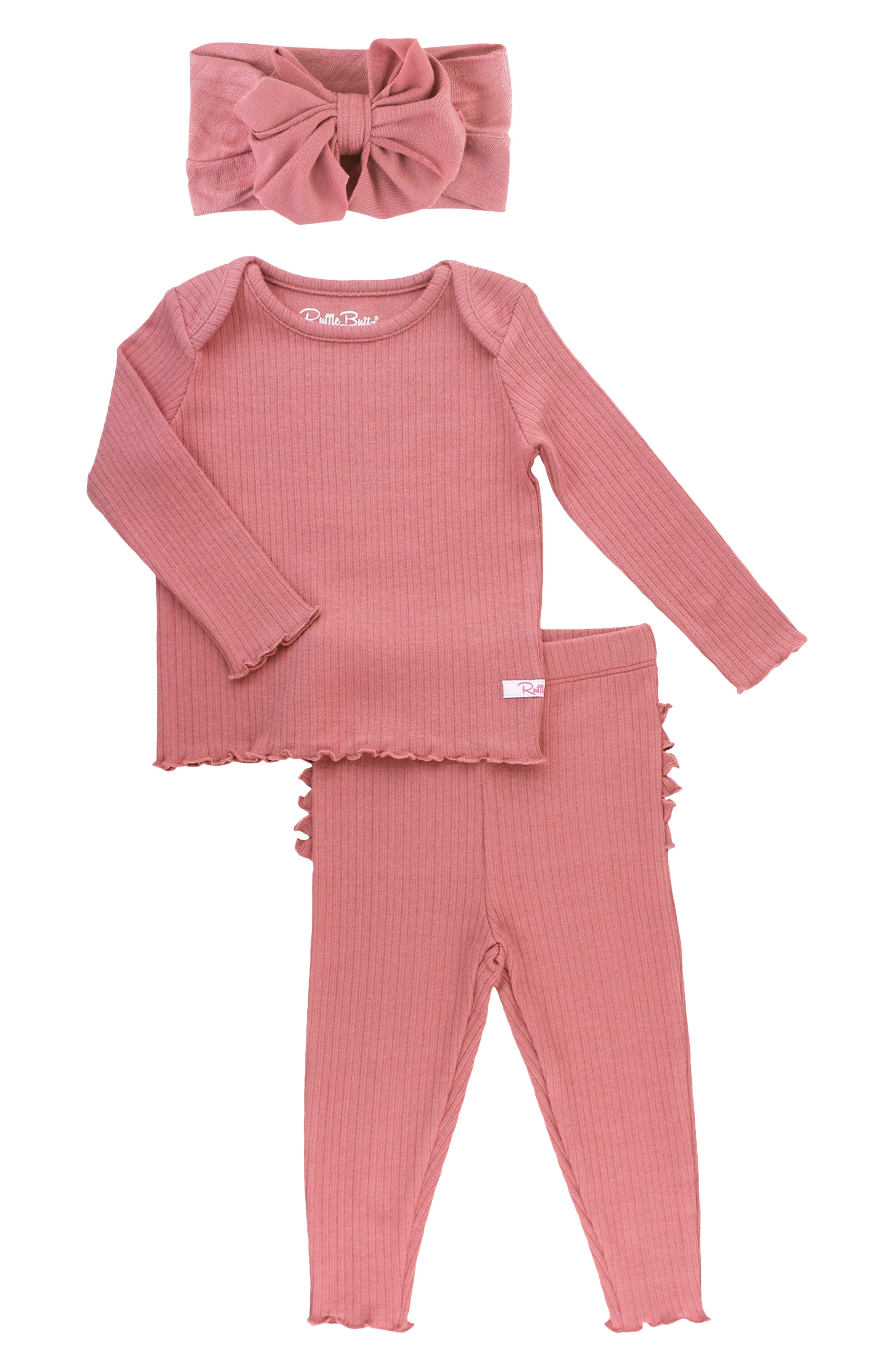 Send your little one sweetly off to sleep with these snug two-piece ruffled pajamas finished with a coordinating head wrap. Style Name: Rufflebutts Mauve Fitted Two-Piece Pajamas & Head Wrap Set (Baby). Style Number: 6125781. Available in stores.