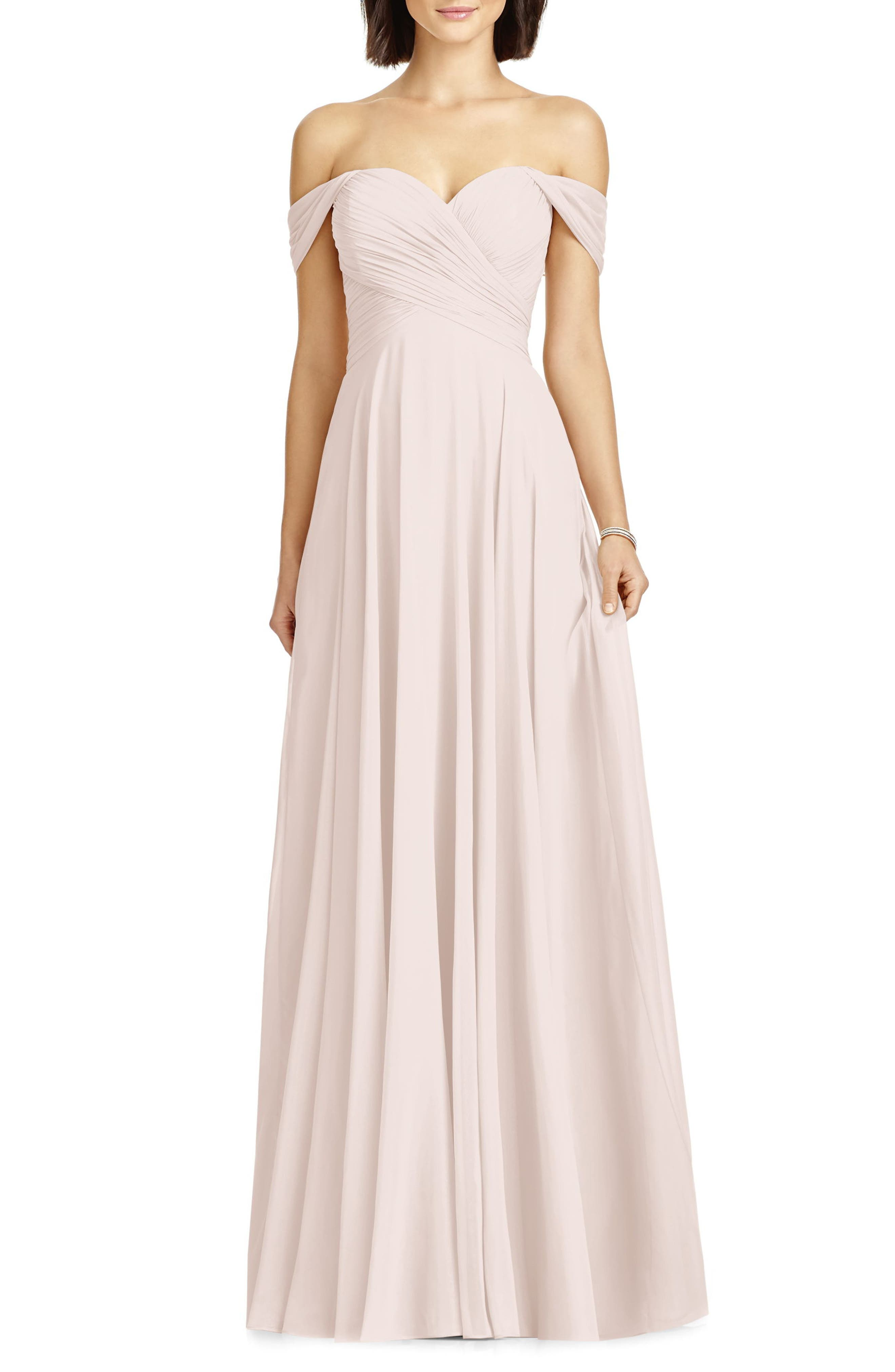 This lovely chiffon gown shaped with densely ruched panels that wrap the bodice is designed to flatter all figures in your wedding party. Softly draped cap sleeves frame the sweetheart neckline, while the gently pleated skirt falls to a sweeping floor length. Style Name: Dessy Collection Lux Ruched Off The Shoulder Chiffon Gown (Regular & Plus Size). Style Number: 5370916. Available in stores.