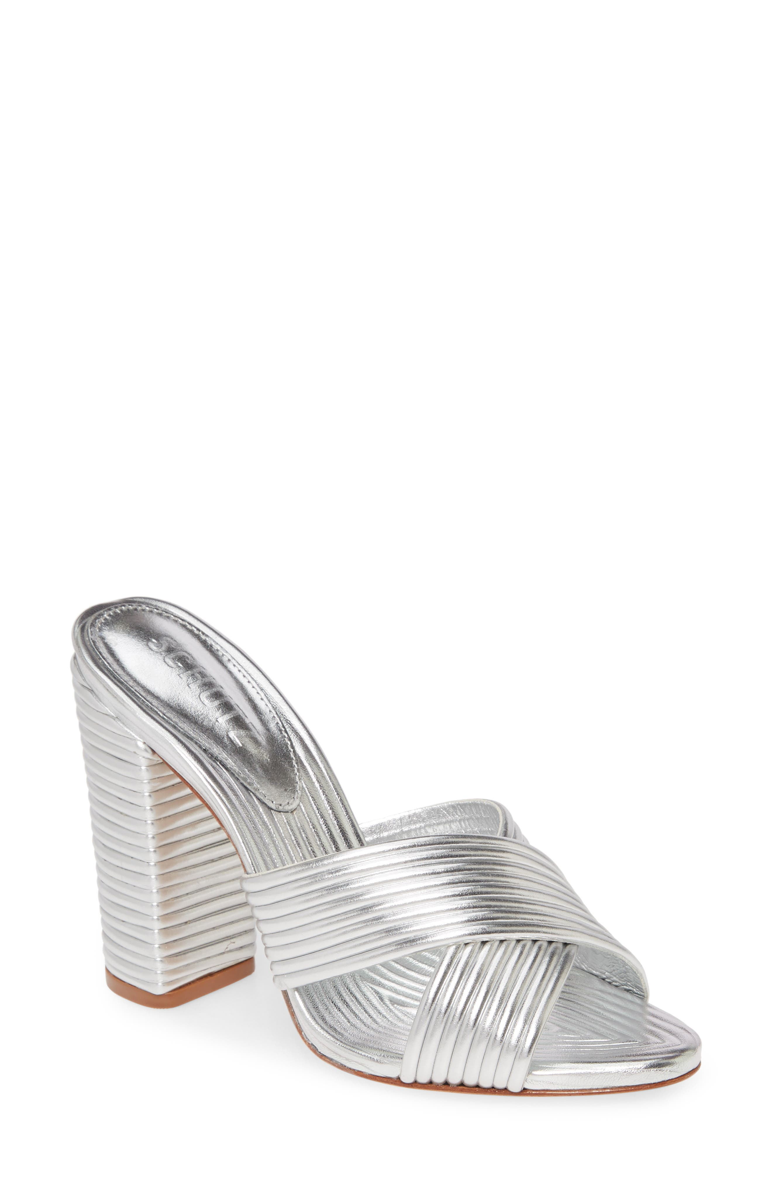 Channel quilting brings eye-catching texture to a shimmering slide sandal styled with thick crisscross straps and a lofty block heel. Style Name: Schutz Emma Dale Block Heel Slide Sandal (Women). Style Number: 5911284 1. Available in stores.
