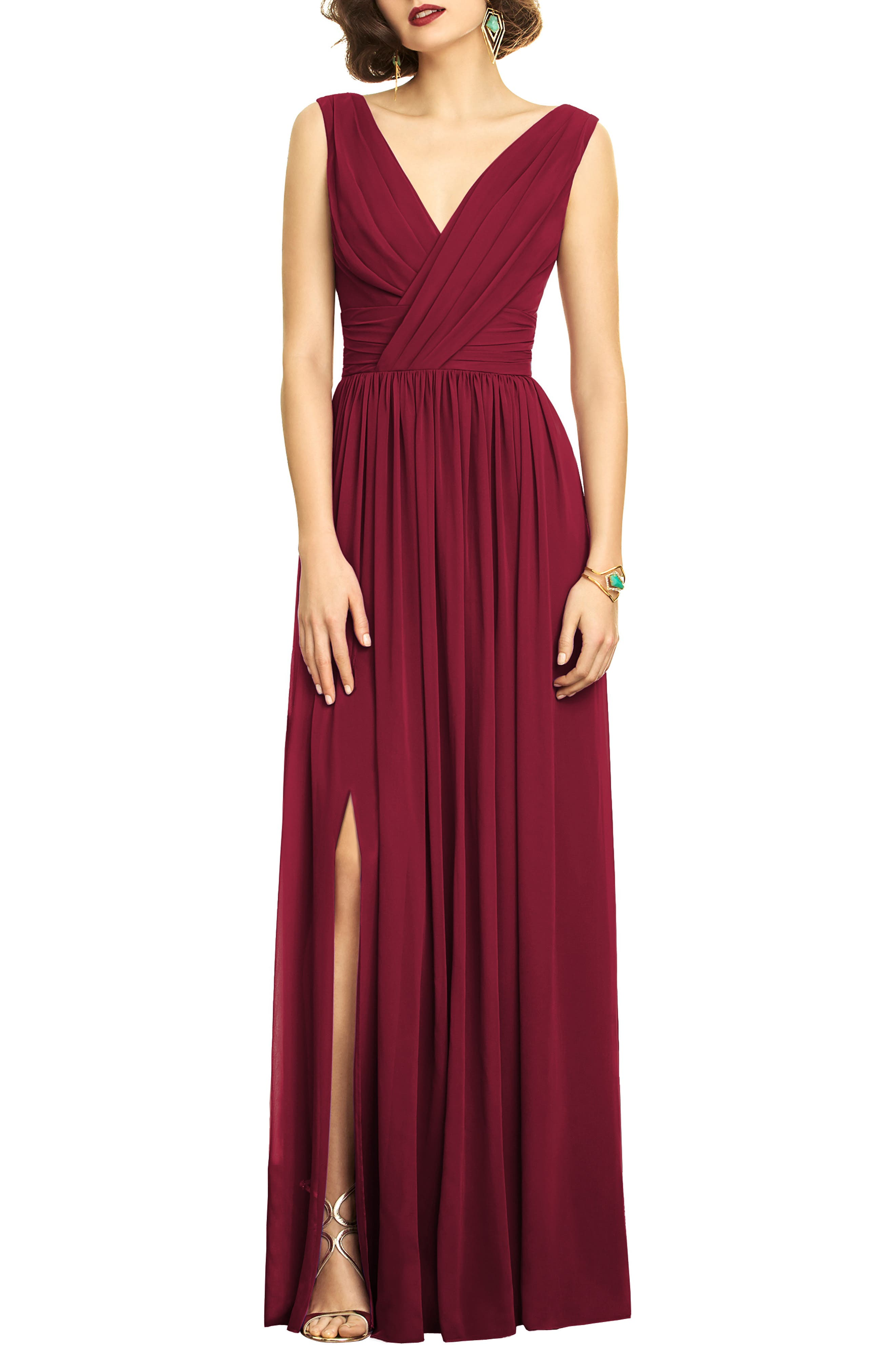 A beautifully draped chiffon gown evokes Old Hollywood glamour with a ruched bodice, flattering double necklines and a dramatically slit column skirt. Style Name: Dessy Collection Surplice Ruched Chiffon Gown. Style Number: 5253758 4. Available in stores.