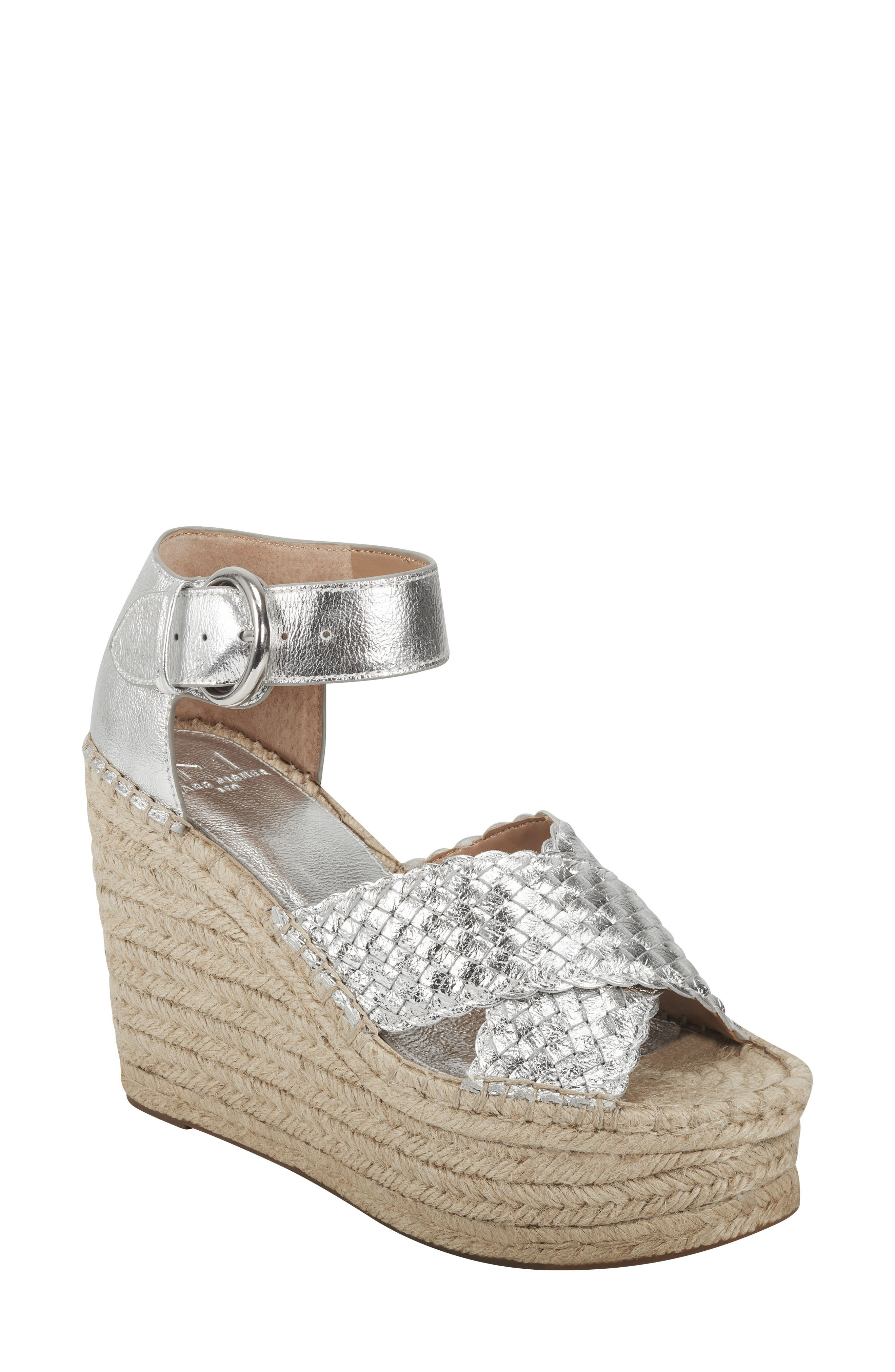 A sky-high espadrille-style wedge and platform call attention to a breezy sandal featuring basket-woven straps that crisscross at the toe. Style Name: Marc Fisher Ltd Aylon Espadrille Sandal (Women). Style Number: 6003556. Available in stores.