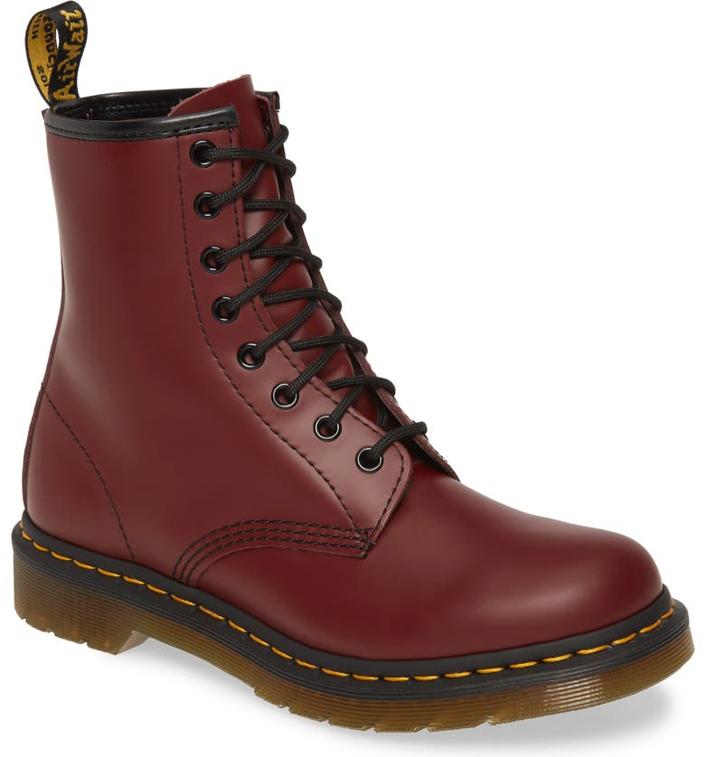 Cherry Red and Black Dr.Martens boots on a rack for sale