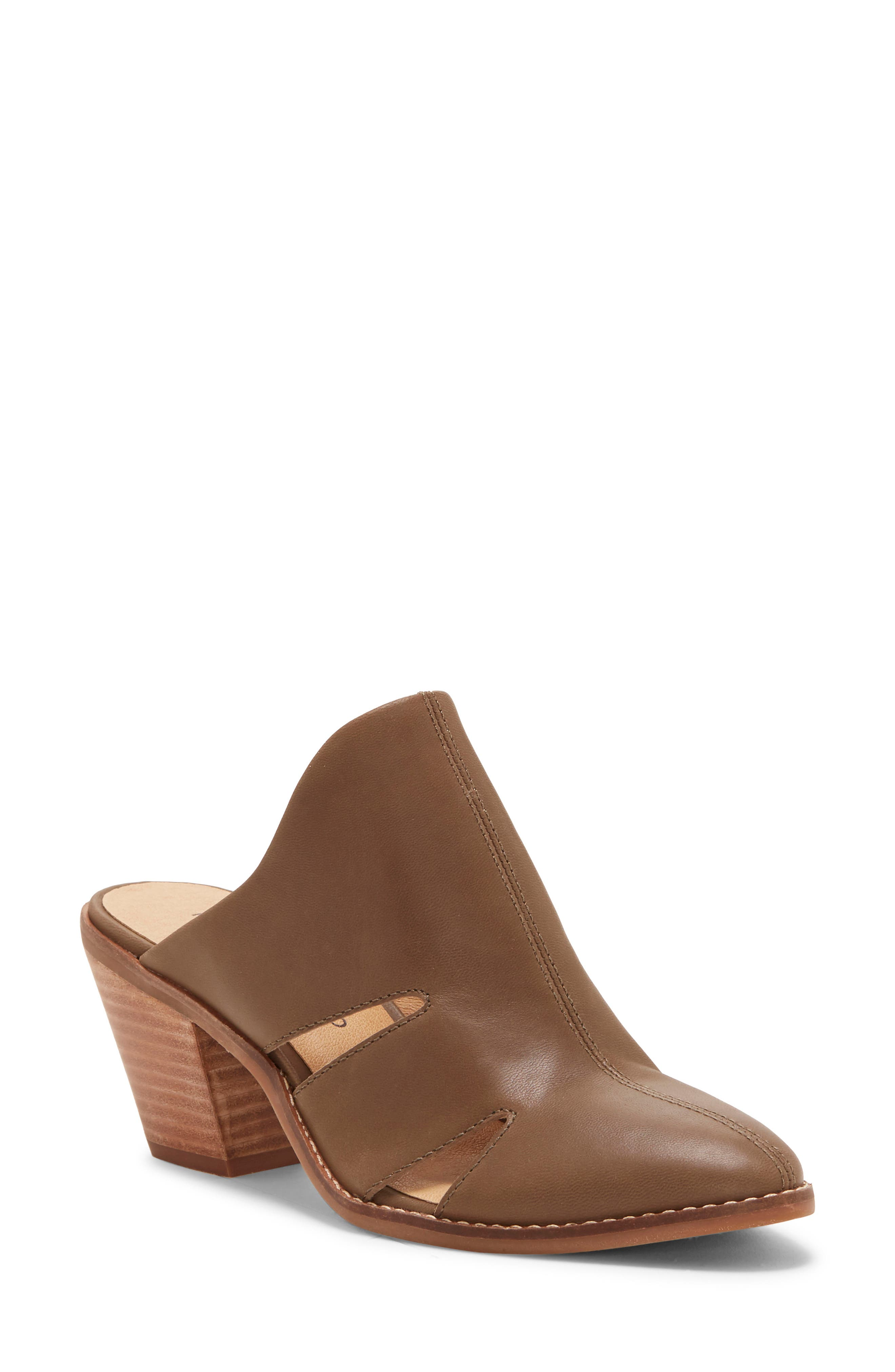Slim cutouts keep feet breezy in a statement-making mule set on a cone-shaped stacked heel. Style Name: Lucky Brand Orinthia Mule (Women). Style Number: 5958723. Available in stores.
