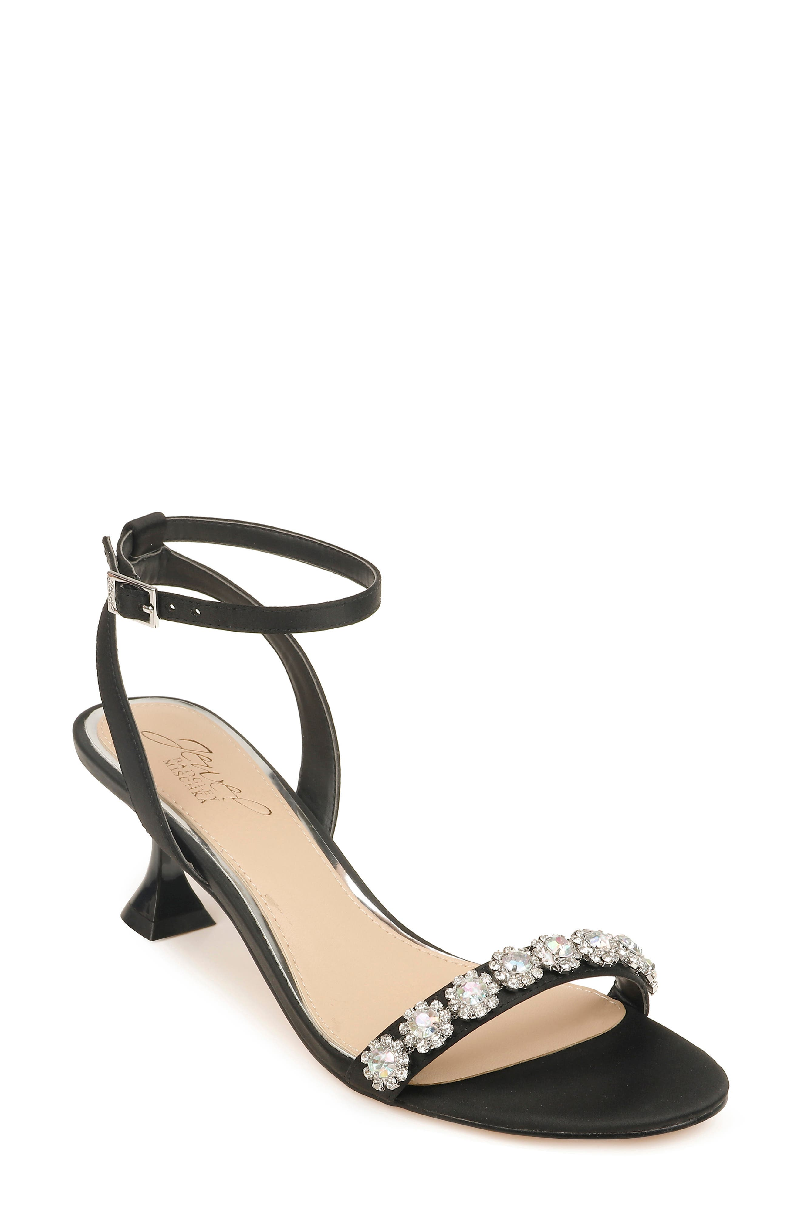 Make the party rounds in a crystal-embellished sandal featuring a lightly padded footbed and flared, pedestal-like heel so you can circulate the room with ease. Style Name: Jewel Badgley Mischka Fantasia Crystal Embellished Sandal (Women). Style Number: 6068851. Available in stores.