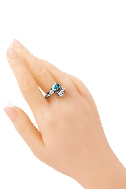 Image of DEVATA Bali Filigree Sterling Silver ByPass Ring Embellished by 18K Gold Accents and Sky Blue Topaz