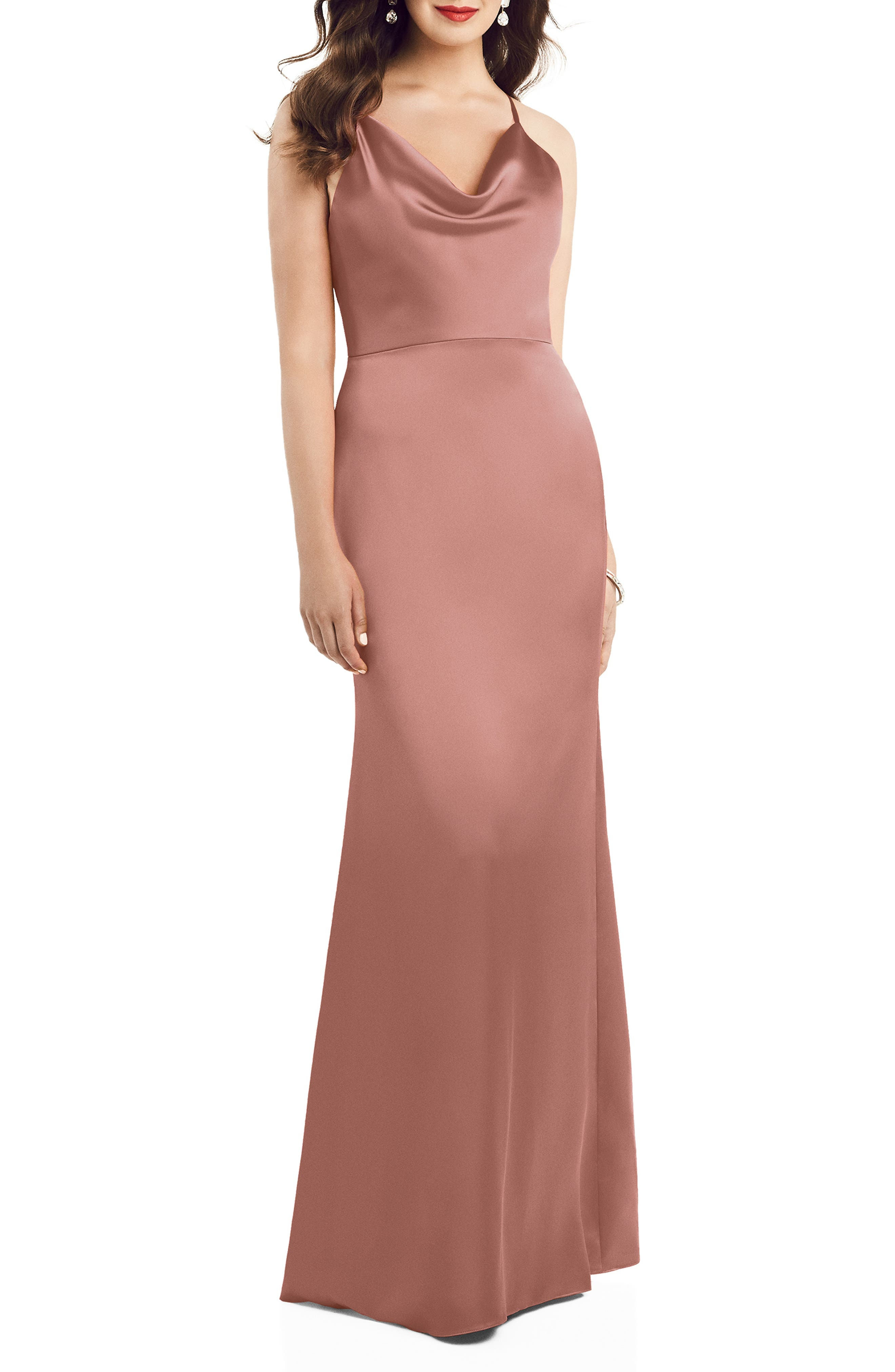 This cowl-neck gown is crafted from a luxe charmeuse that flows eloquently down the trumpet skirt and features an open back crisscrossed by spaghetti straps. Style Name: Dessy Colleciton Cowl Neck Charmeuse Trumpet Gown. Style Number: 6003840. Available in stores.