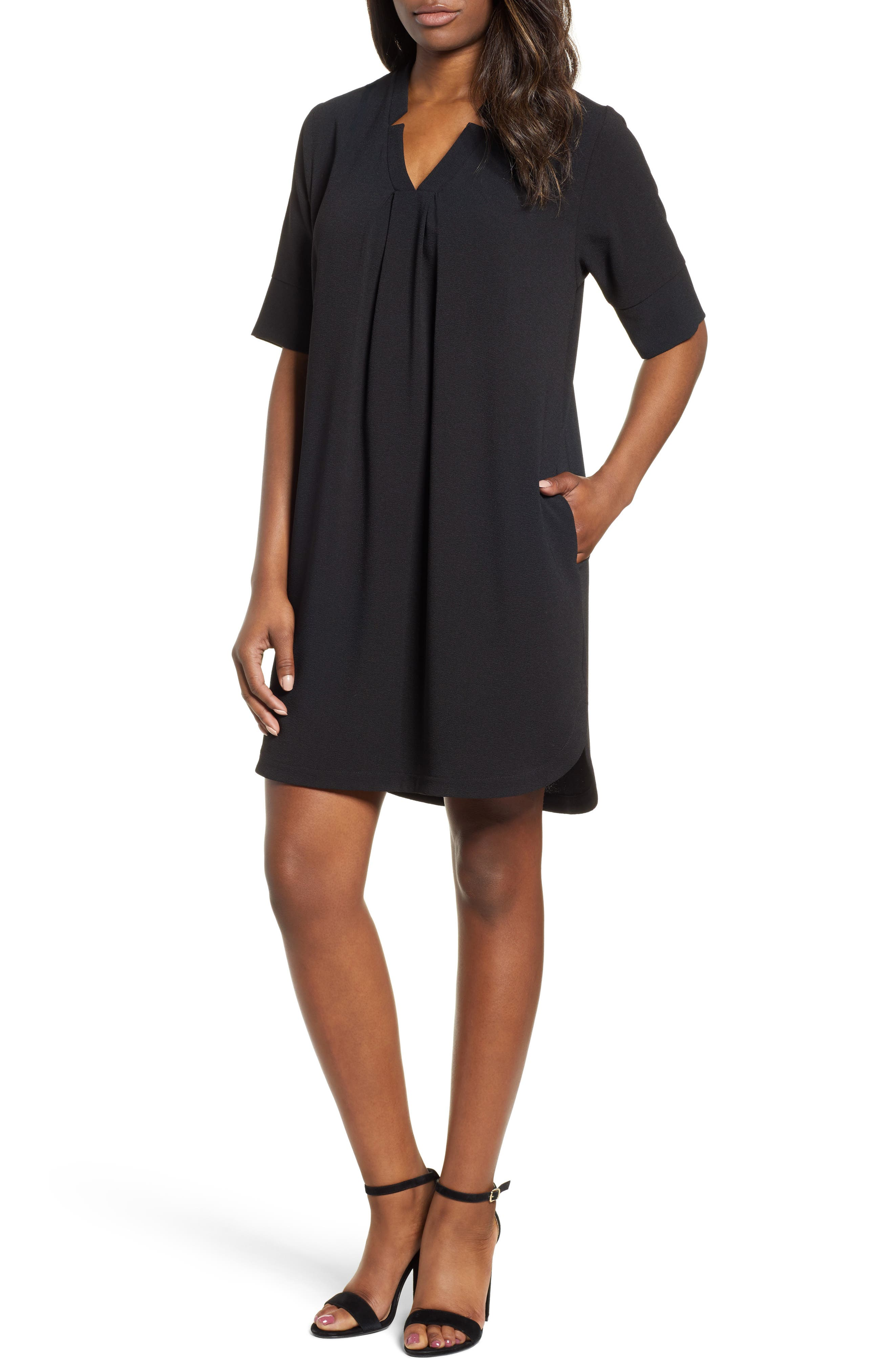 Freely flowing and leg-showing, this kicky little dress features a sweetly split neck and a shirttail hemline. Style Name: Bobeau Pleat Front Curved Hem Shirtdress (Regular & Petite). Style Number: 5631536 1. Available in stores.