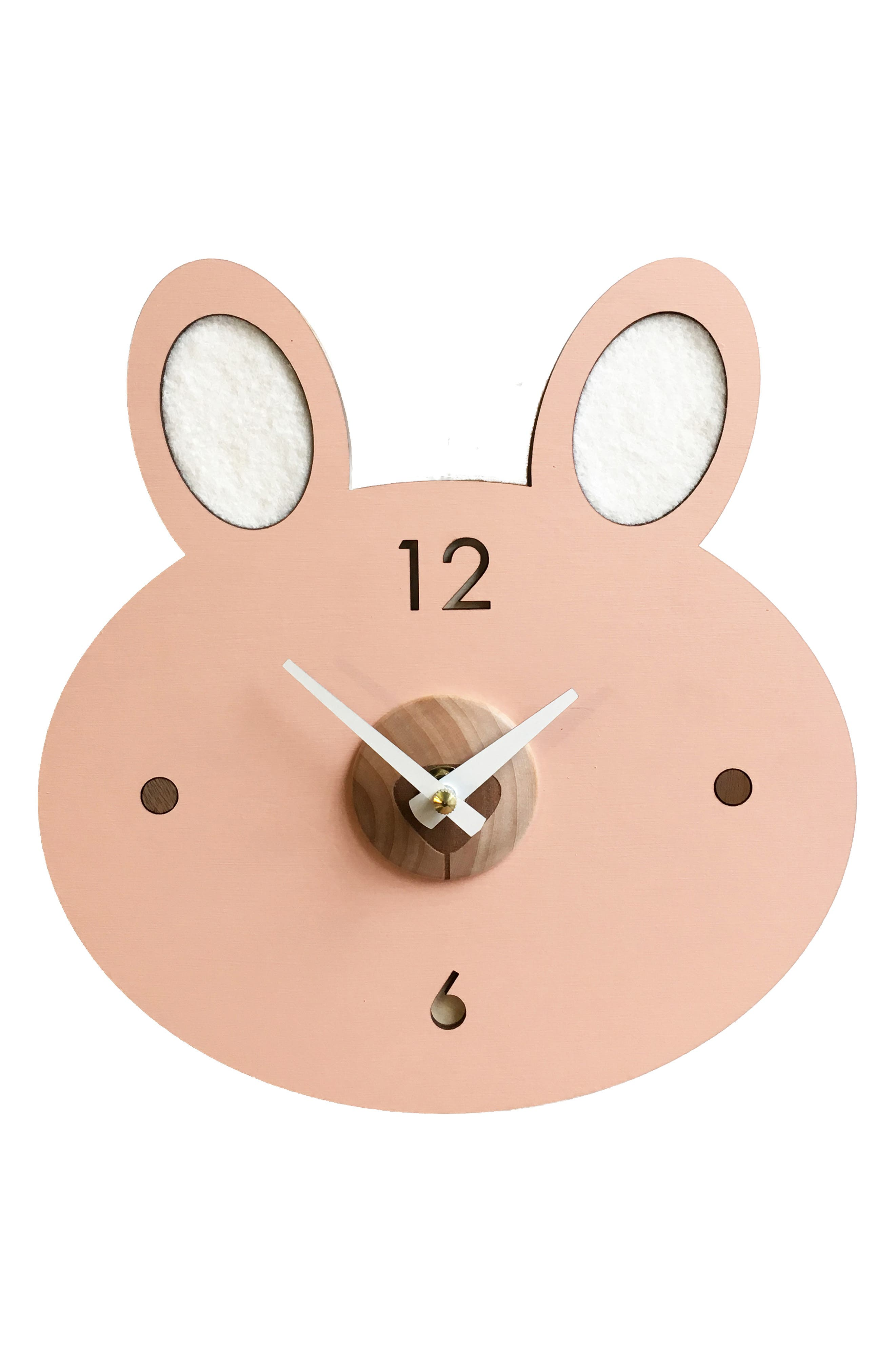An adorable and modern addition to any nursery decor, this hand-painted clock is shaped like a minimalist bunny with soft felted-wool ears. Style Name: Tree By Kerri Lee Menagerie Wooden Bunny Clock. Style Number: 6064511. Available in stores.