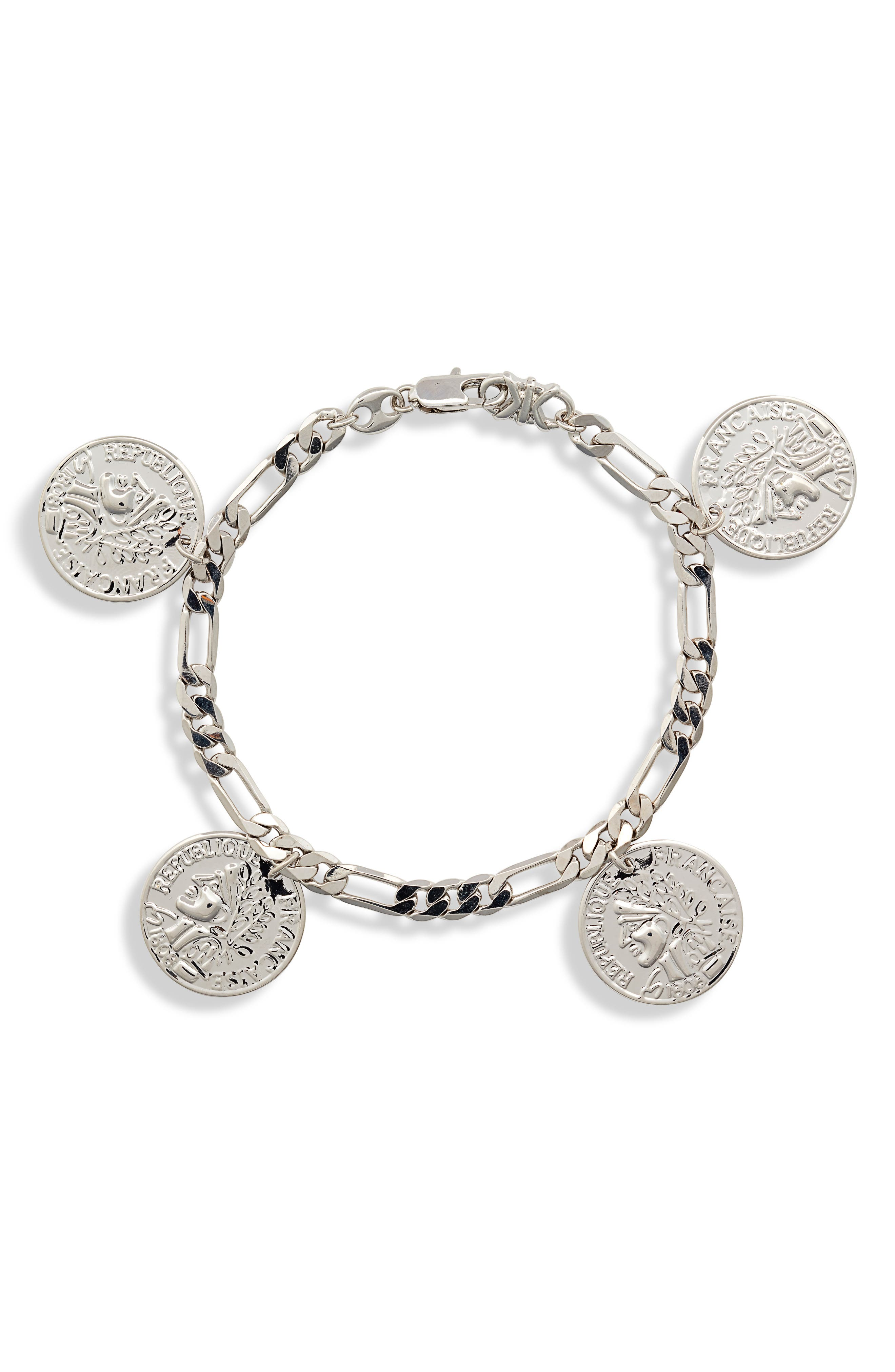 A gleaming addition to the coin-jewelry trend, this figaro chain bracelet jangles with a quartet of etched charms. Style Name: Sterling Forever Figaro Charm Bracelet. Style Number: 5953203. Available in stores.