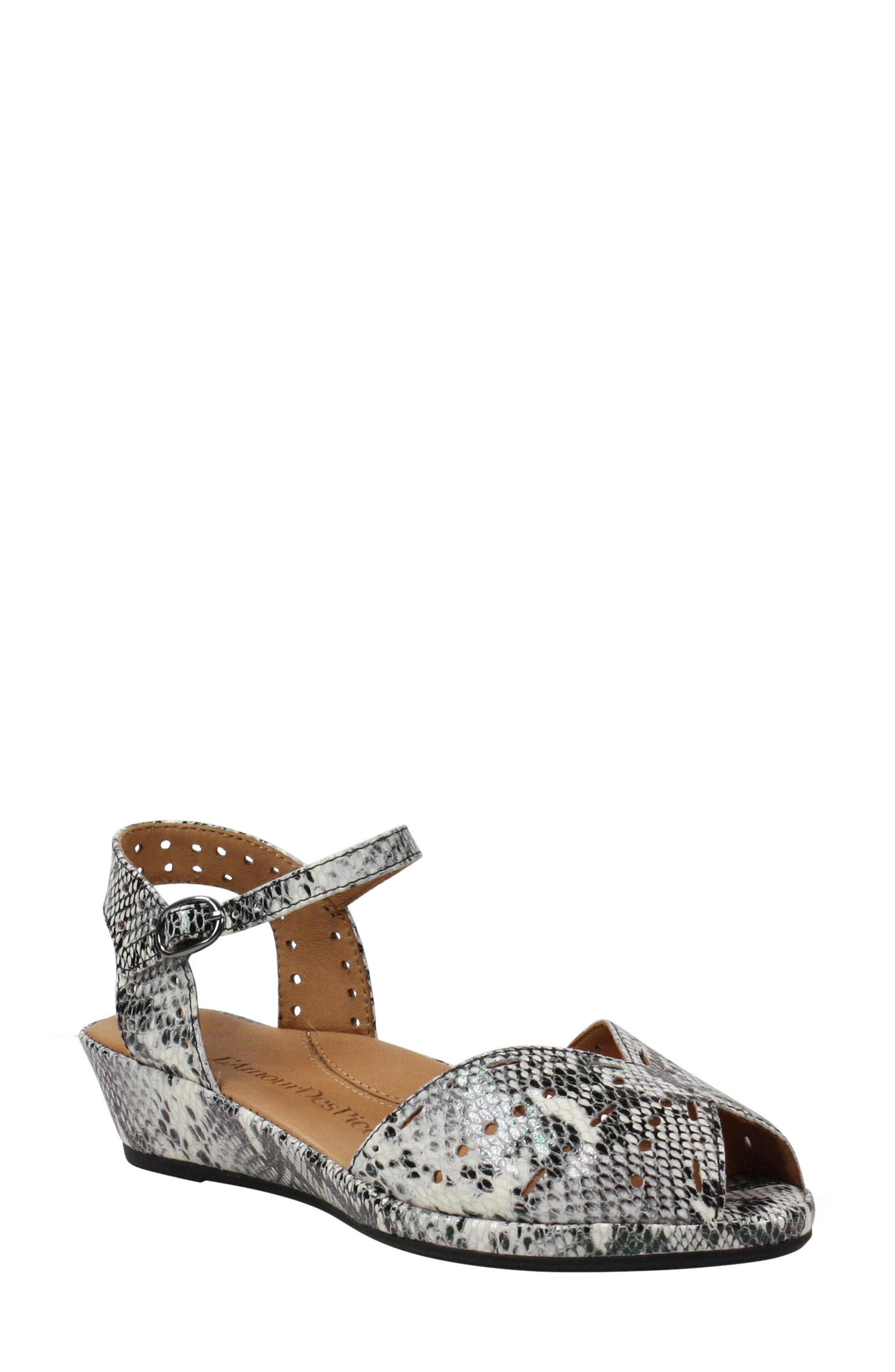 Punched-out perforations add pretty texture to a quarter-strap wedge sandal made with a comfortable memory foam-cushioned footbed. Style Name:L\\\'Amour Des Pieds Brenn Wedge Sandal (Women). Style Number: 6010496. Available in stores.