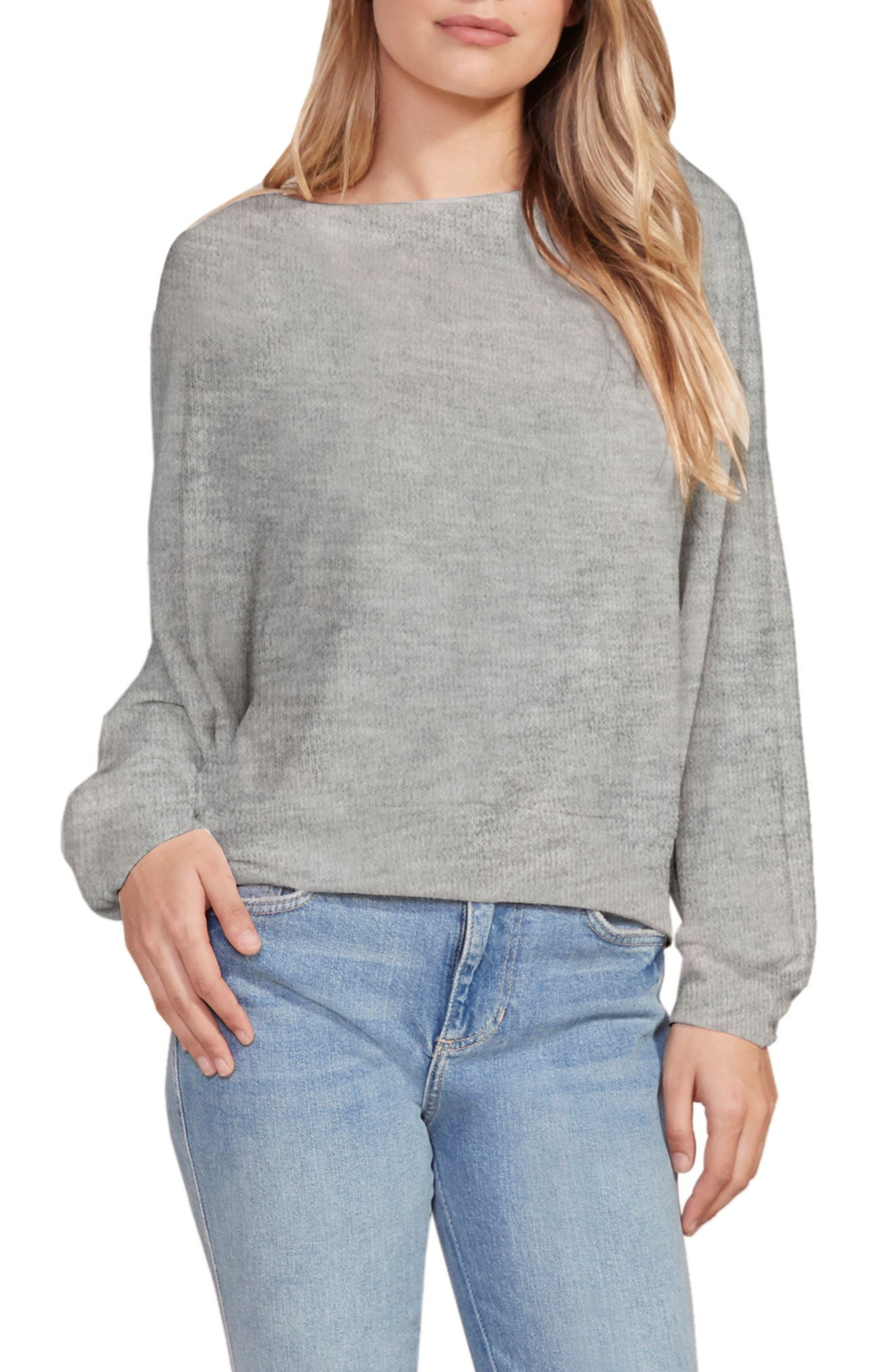 Slouchy dolman sleeves and a boat neck make you feel extra cool and relaxed in this soft sweater in a versatile heathered hue. Style Name: Cupcakes And Cashmere Nirvana Sweater. Style Number: 6086869. Available in stores.