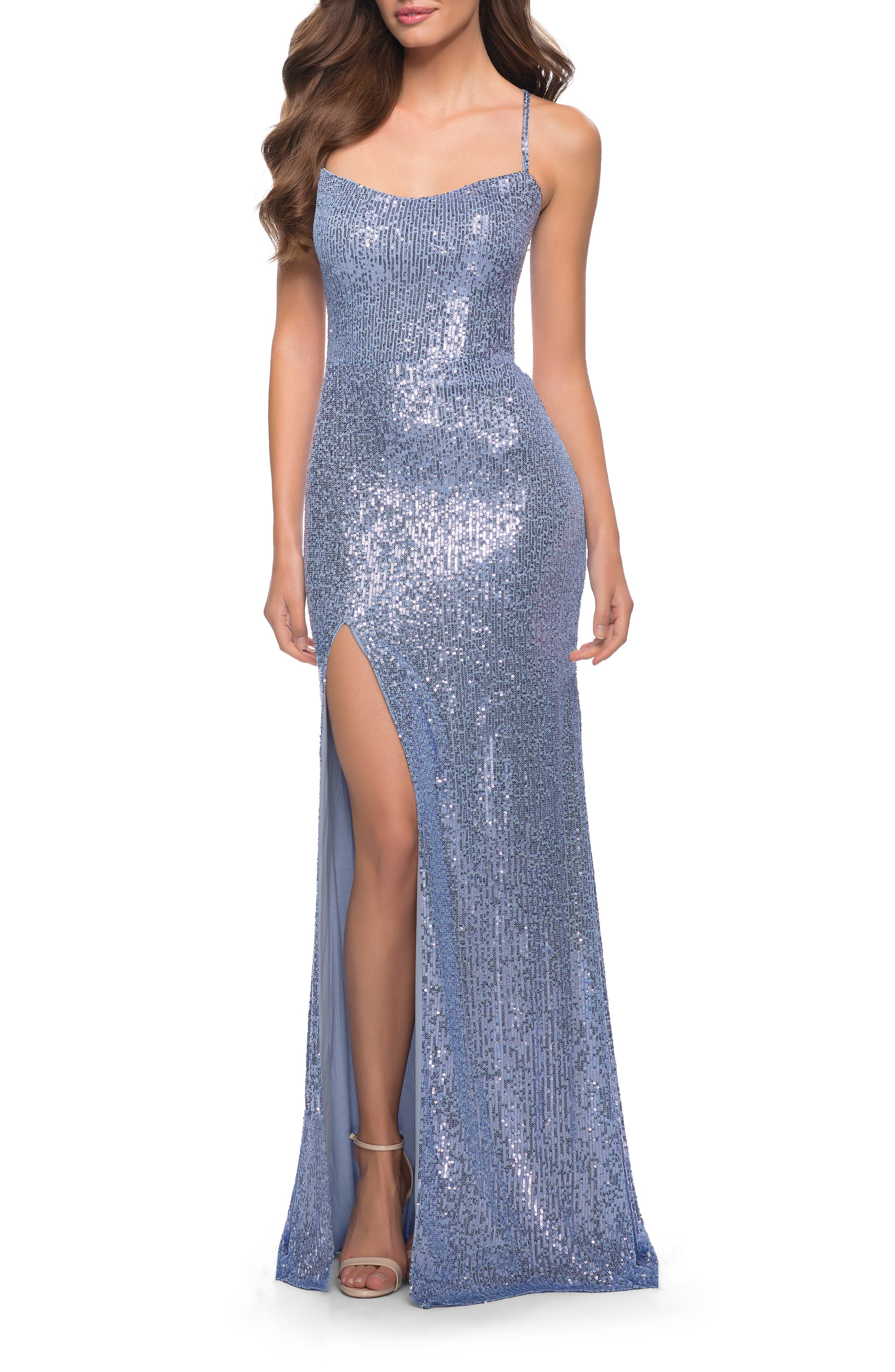 Vertical rows of tiny sequins add length while capturing every ray of light, making this skin-baring, open-back gown even more alluring. Style Name: La Femme Sequin Open Back Gown. Style Number: 6169505. Available in stores.