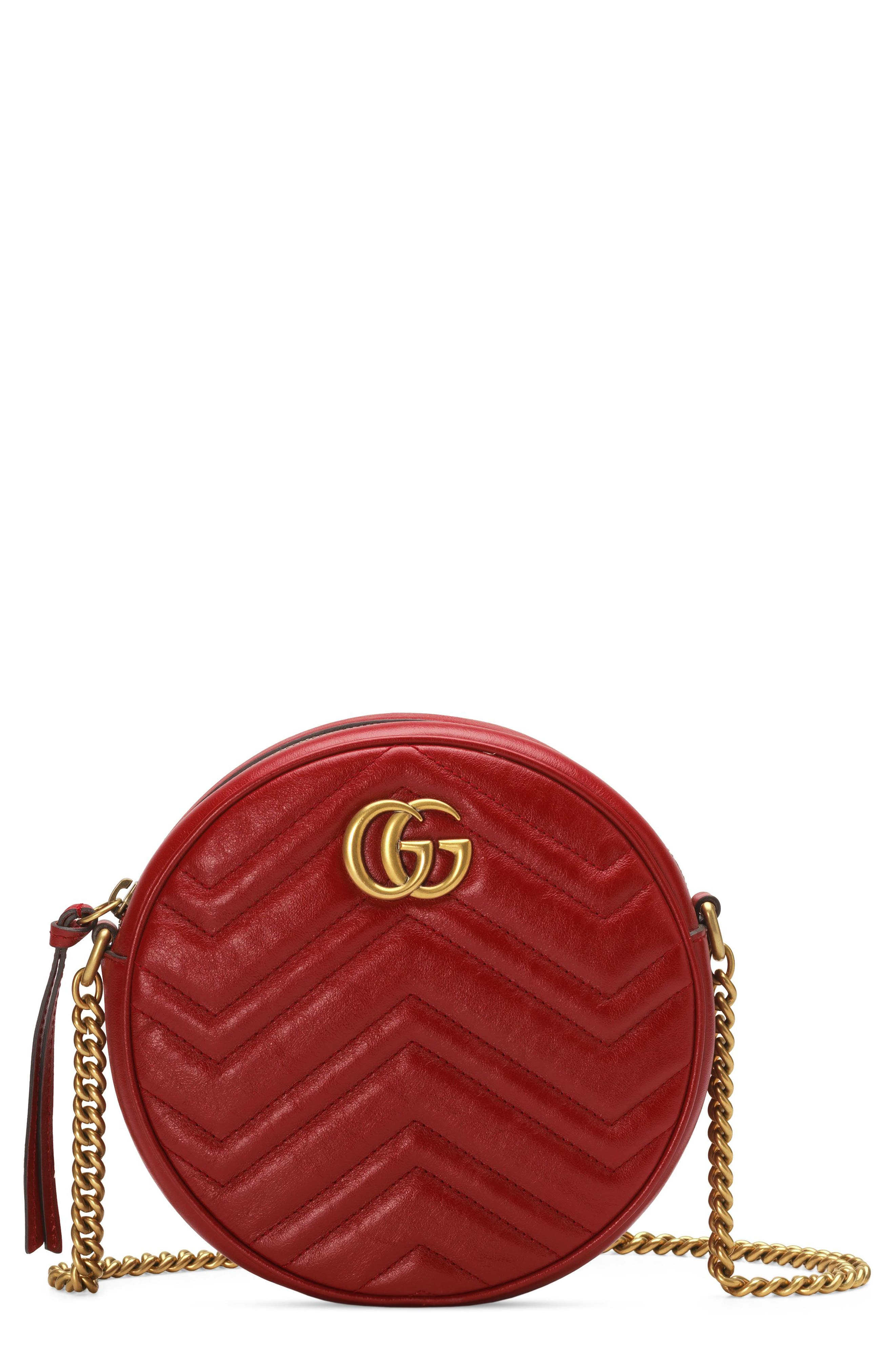 Double-G hardware inspired by a \\\'70s-era archival design rounds out the chic look of a leather bag detailed with matelasse chevrons and a quilted heart. Style Name: Gucci Mini Gg Matelasse Round Leather Shoulder Bag. Style Number: 5742048. Available in stores.