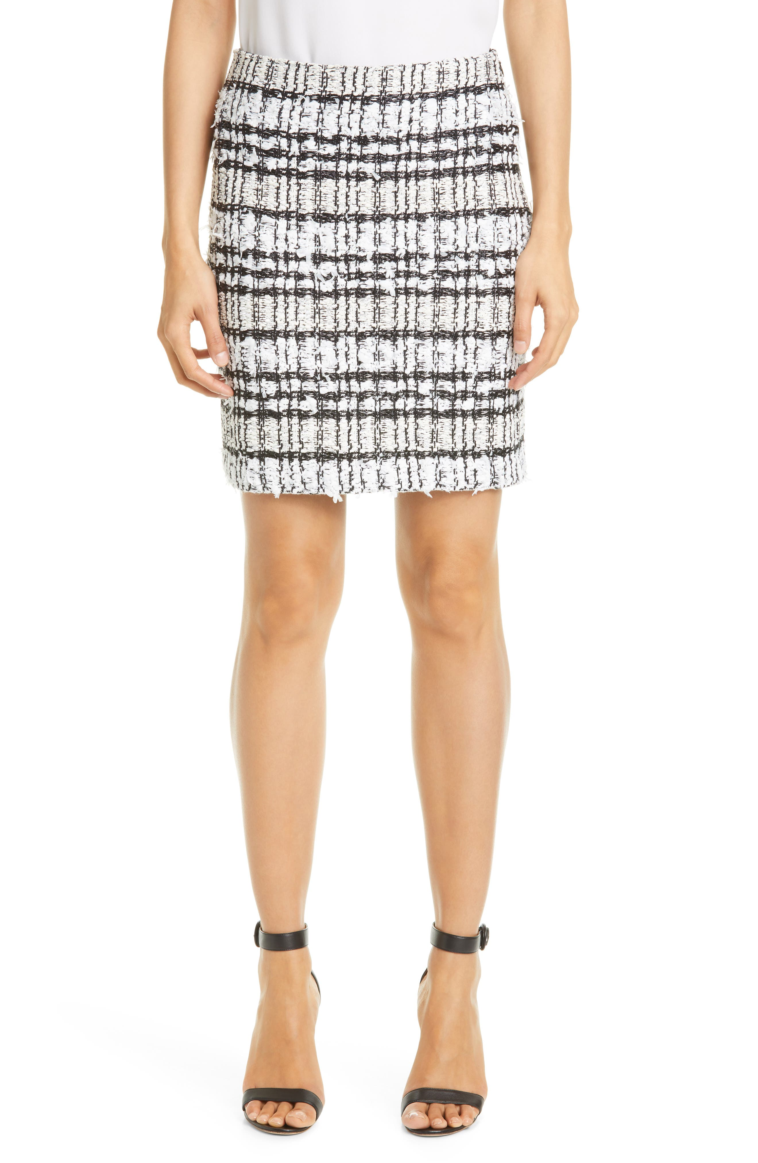 This slim skirt makes an urbane statement with richly textured black-and-white yarns knit into a contemporary plaid pattern. Style Name: St. John Collection Artisanal Plaid Skirt. Style Number: 6045070. Available in stores.