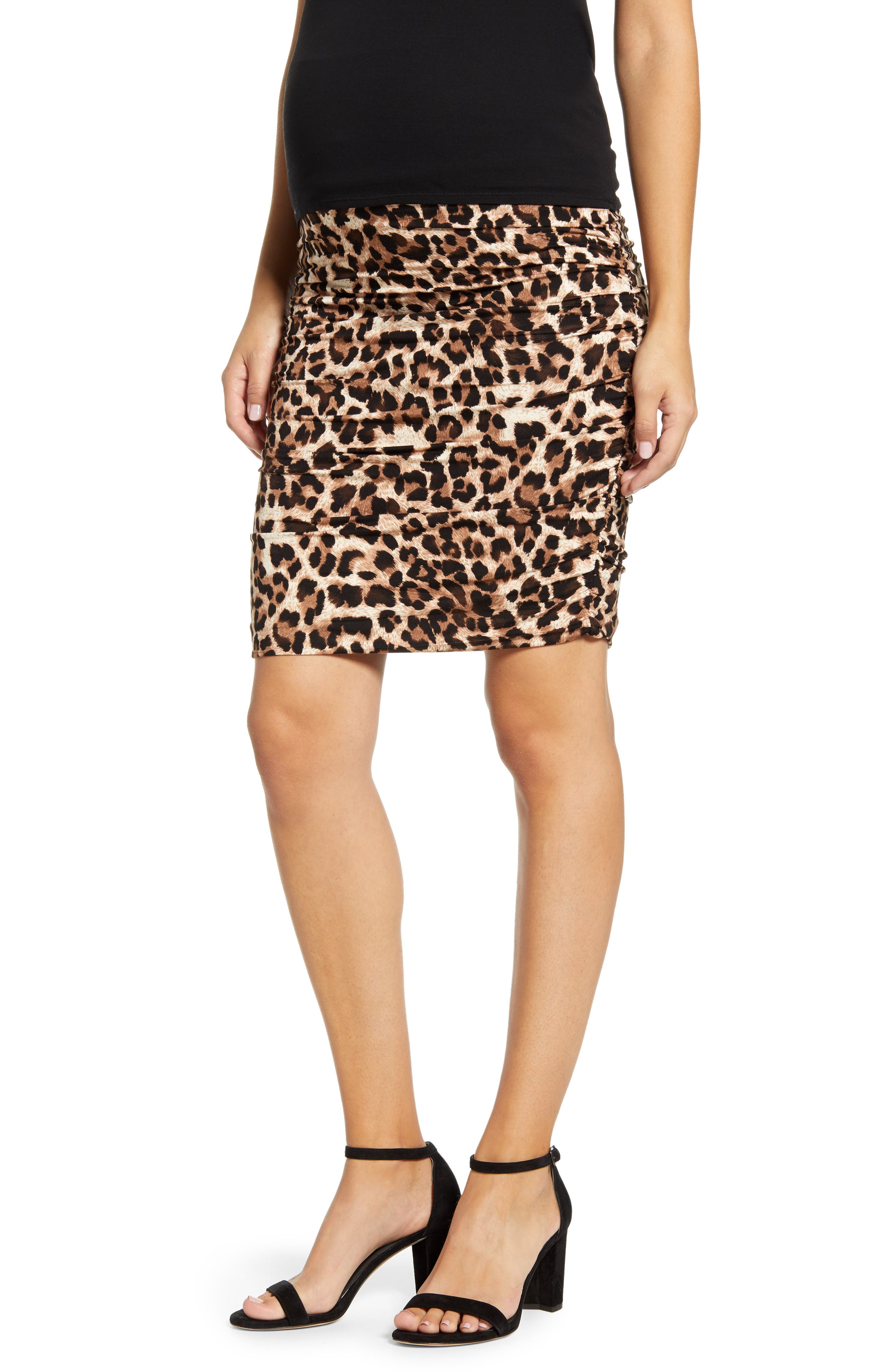 Opt for fierce instead of frumpy for your prego look with this sleek jersey skirt covered in leopard spots and styled with figure-hugging side ruching. An over-the-bump panel provides a secure, flattering fit through every trimester and after. Style Name: Angel Maternity Ruched Leopard Print Maternity Skirt. Style Number: 5932976. Available in stores.