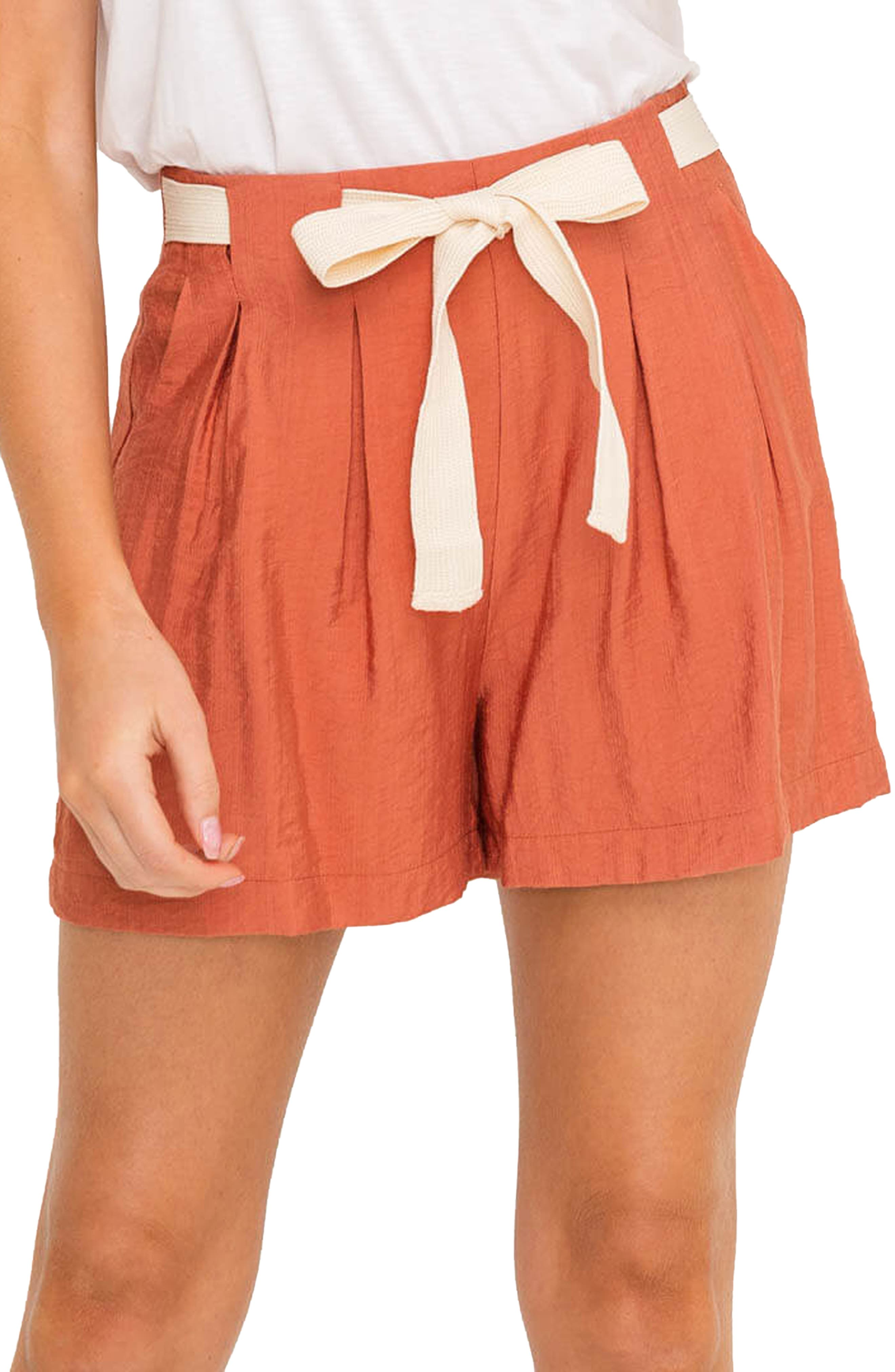 Cute and preppy shorts cut from lightweight, drapey fabric feature a twill-tape tie to cinch the waist and front pleats for a loose, airy fit. Style Name: All In Favor Front Tie Pleated Shorts. Style Number: 6031985. Available in stores.